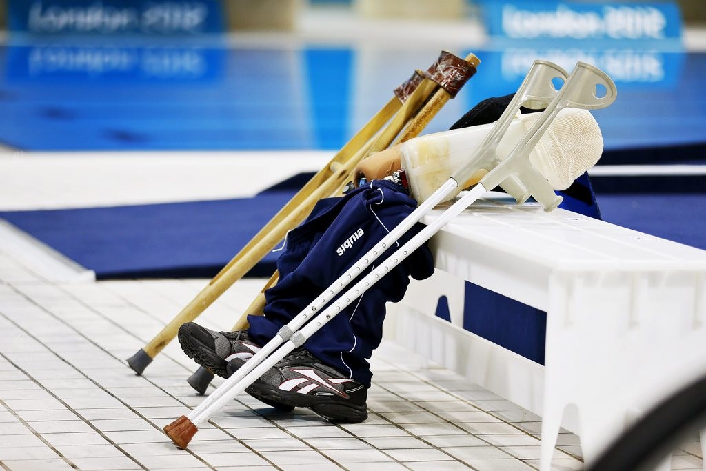 epa03374959 Prostheses and crutches of athletes are seen at the Aquatics Center during the swimming competitions of the Londo