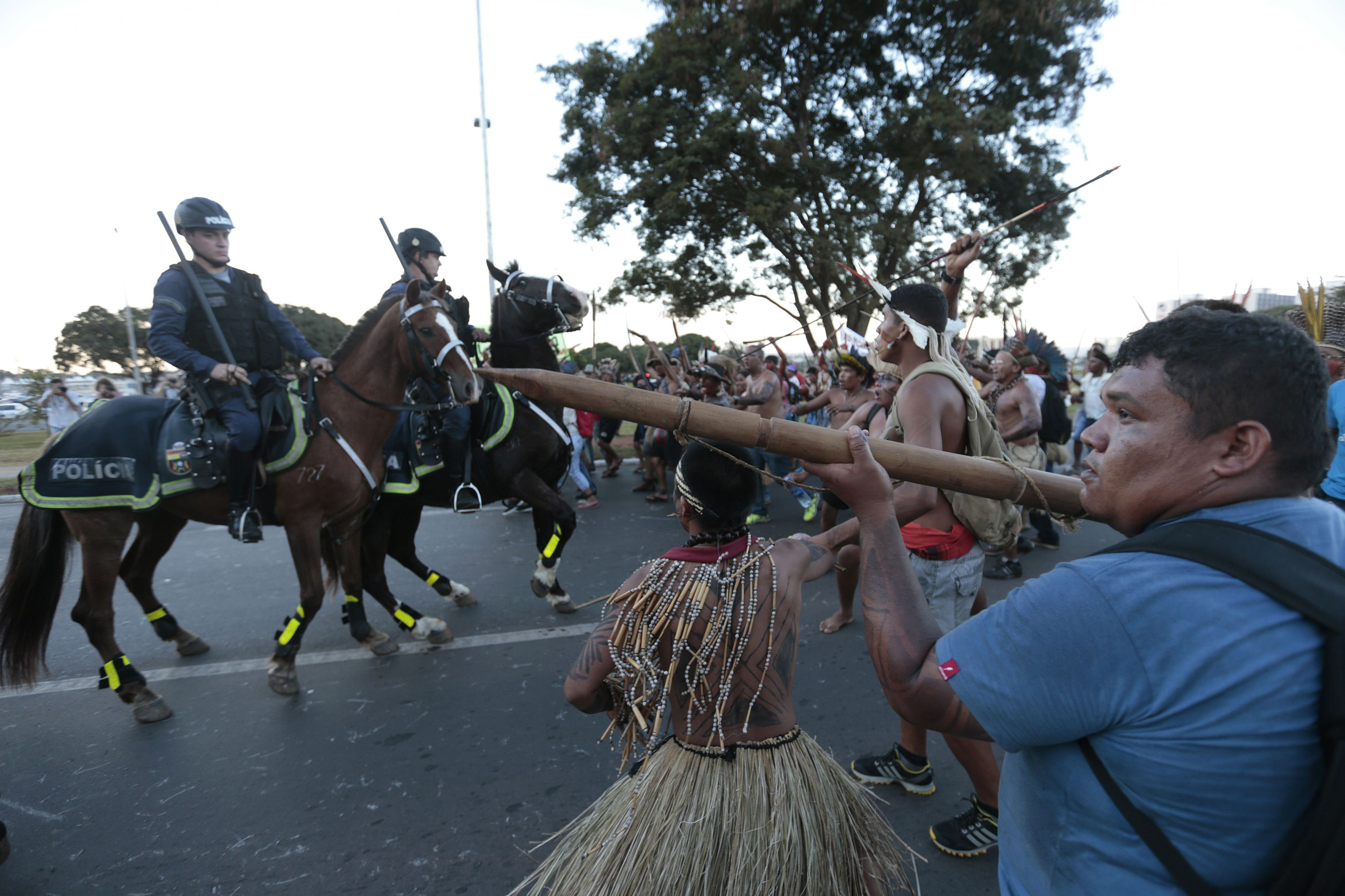 Police confront native Brazilians to prevent them from marching towards the Mane Garrincha soccer stadium during a demonstration in Brasilia May 27, 2014. Indigenous people from different tribes protested against the government's Indian policy and the cos