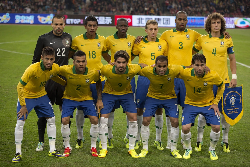 FILE - In this Oct. 15, 2013 file photo, Brazil soccer team poses prior to the start their  international friendly soccer match against Zambia at the Bird's Nest national stadium in Beijing, China. Background from left: Diego Cavalier, Paulinho, Ramires,