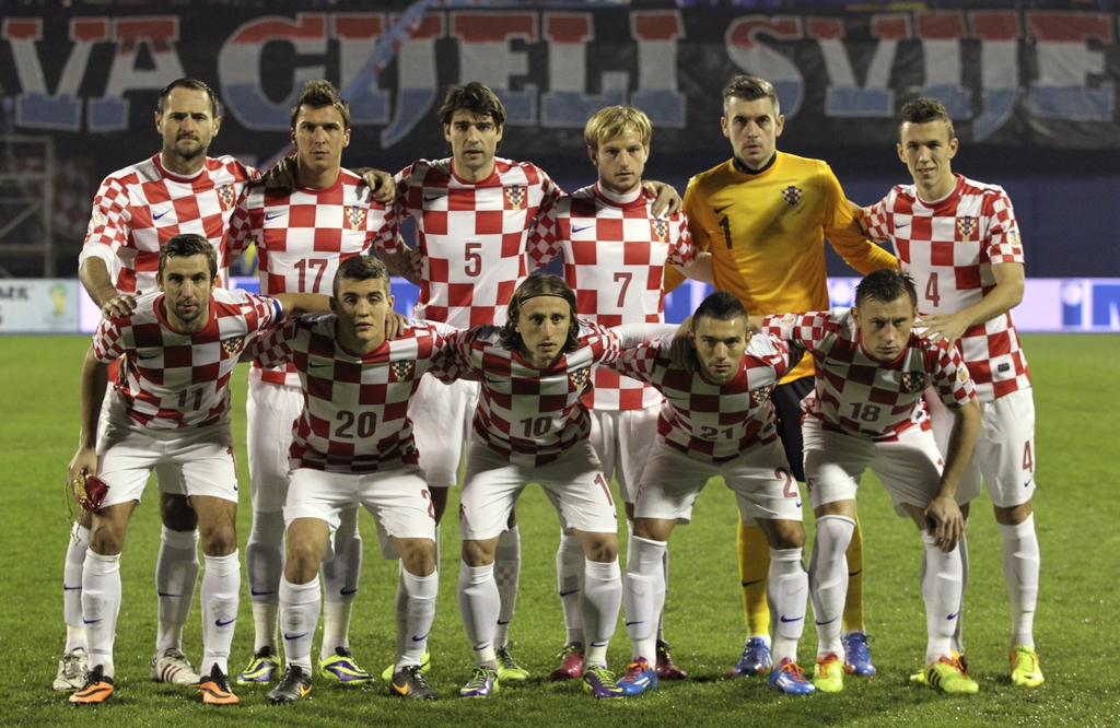 FILE - In this Nov. 19, 2013 file photo, Croatia soccer team poses prior to the start the World Cup qualifying soccer match between Croatia and Iceland in Zagreb, Croatia. Background from left: Josip Simunic, Mario Mandzukic, Vedran Corluka, Ivan Rakitic,