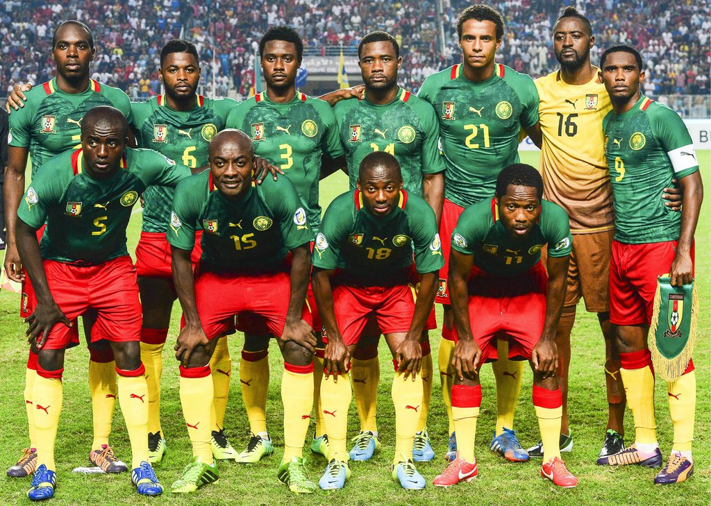epa03968723 FIFA WORLD CUP 2014 TEAMS....Picture taken on 13 October 2013 shows Cameroonian national soccer team players (front row, L-R) Dany Nounkeu, Pierre Webo, Eyong Enoh and Jean Makoun; (back row, L-R) Allan Nyom, Alex Song, Nicolas N'Koulou, Aurel