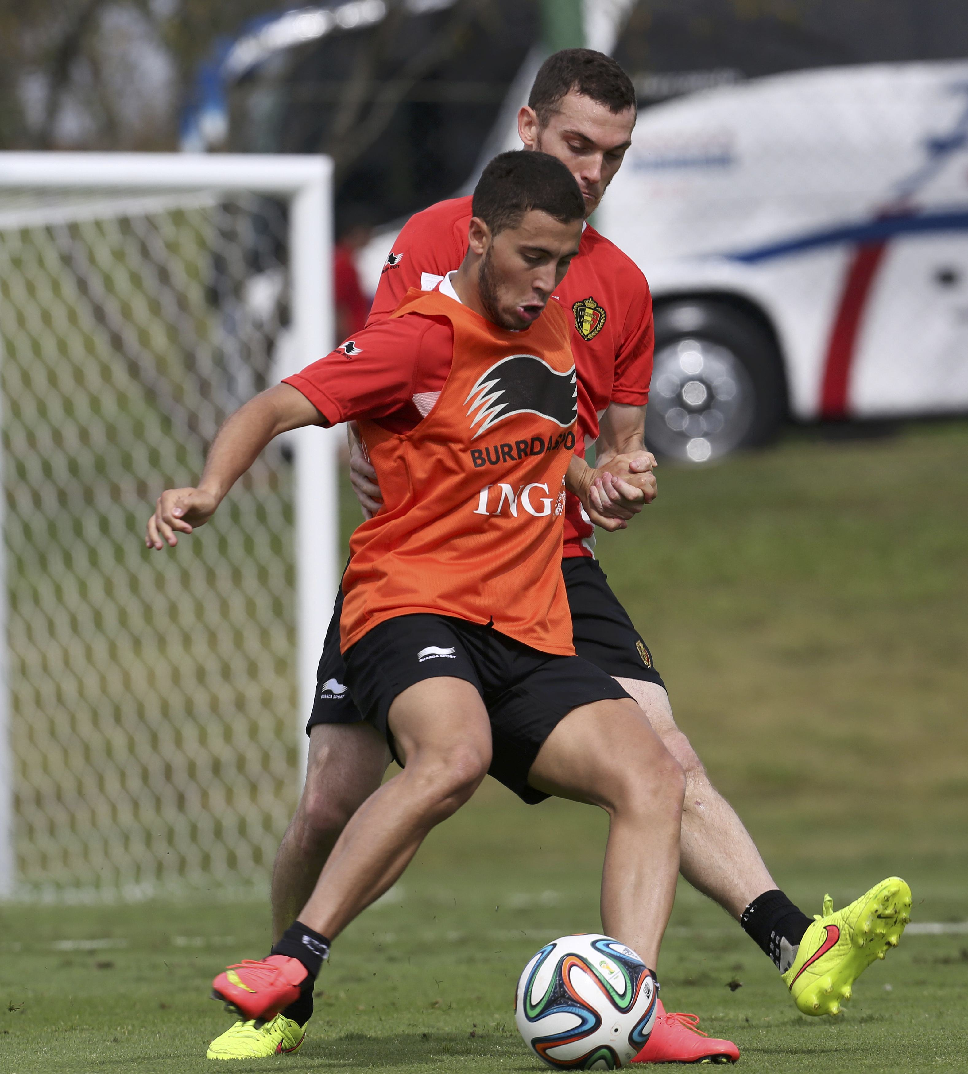 Belgium's national soccer team players Eden Hazard (Front) and Thomas Vermaelen fight for the ball during a training session in Mogi das Cruzes, near Sao Paulo June 14, 2014. Belgium will play its first match of the 2014 World Cup against Algeria on June