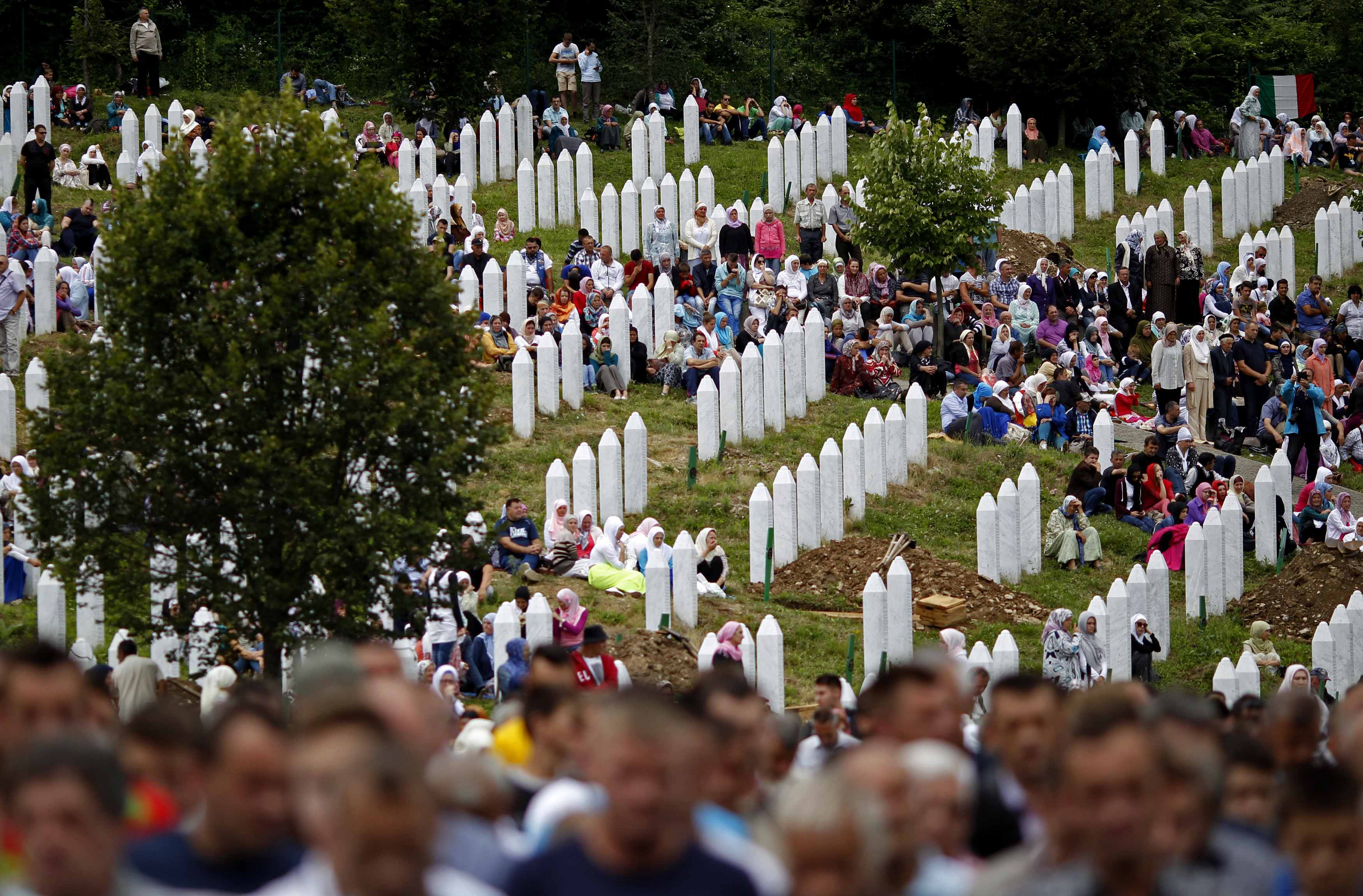 Bosnian Muslims attend the mass funeral of 175 newly identified victims from the 1995 Srebrenica massacre, in Potocari Memorial Center, near Srebrenica, July 11, 2014. Family members, foreign dignitaries and guests are expected to attend a ceremony in Sre