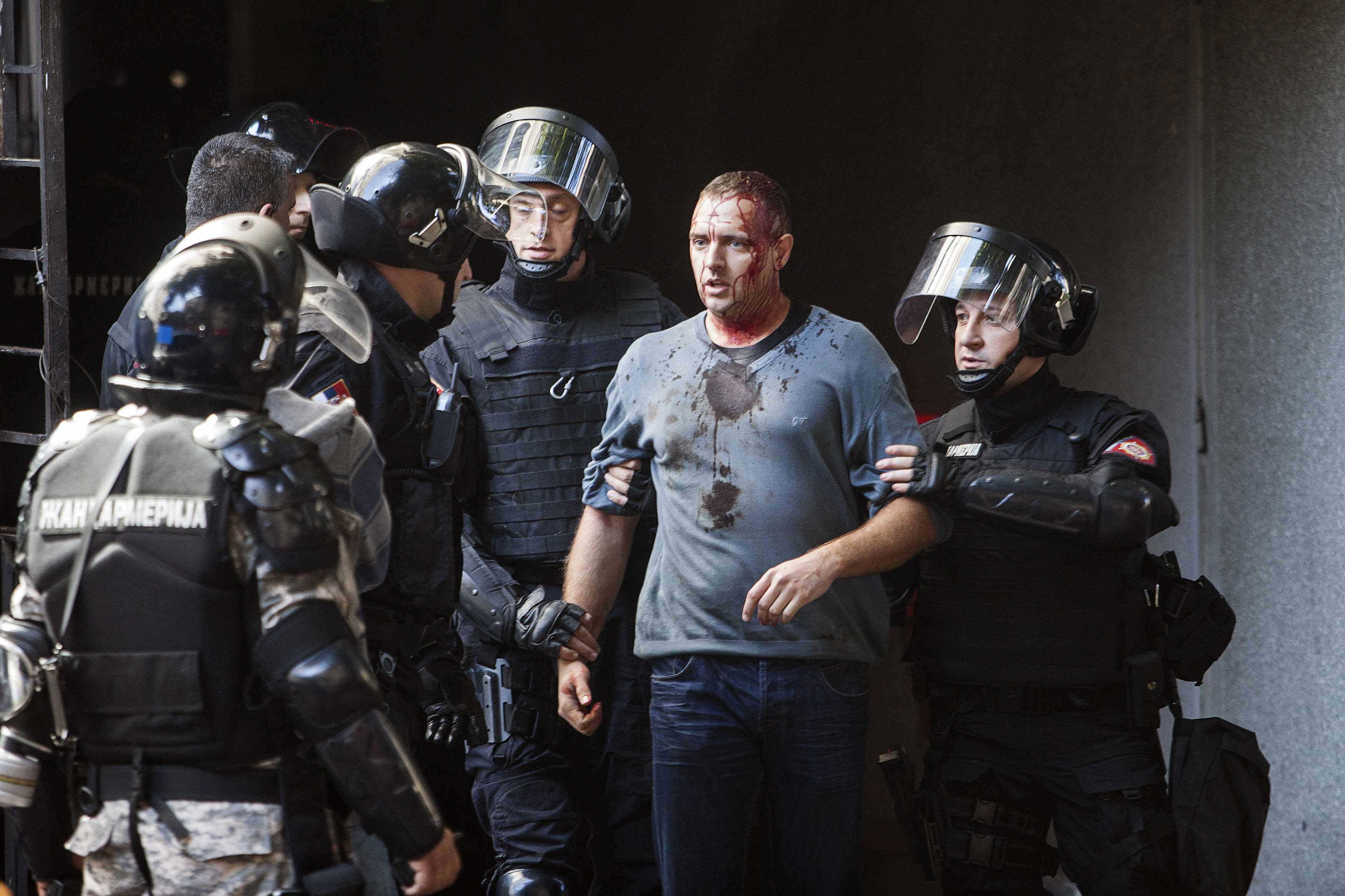 Riot police detain an anti gay activist during a Pride march in Belgrade, September 28, 2014. Gay rights activists in Serbia held their first Pride march in four years on Sunday, walking through Belgrade streets emptied of traffic and pedestrians by a mas