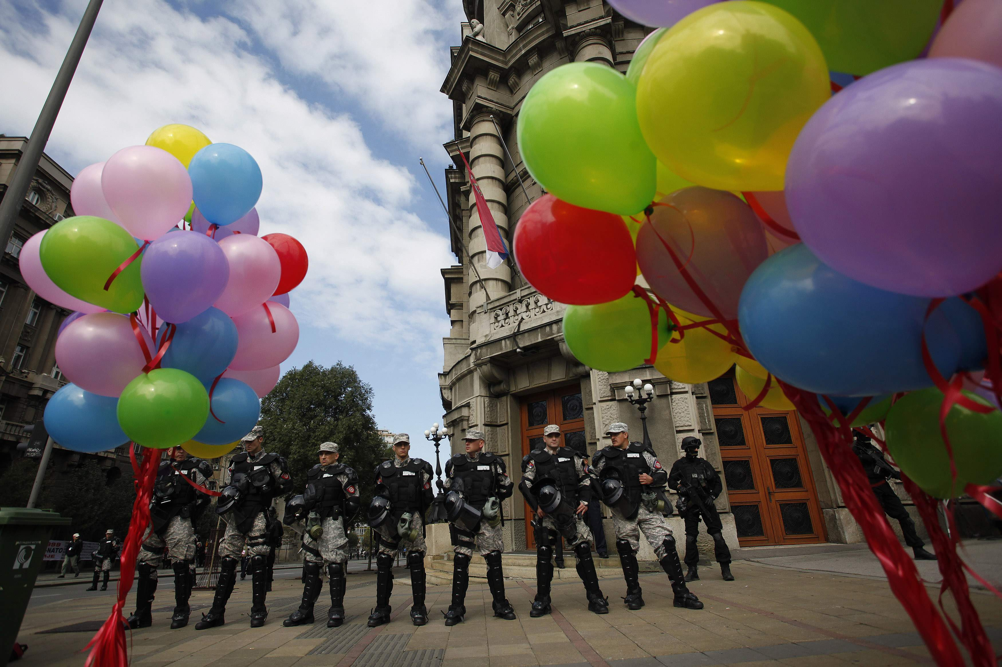 Riot police stand guard during a Pride march in Belgrade, September 28, 2014. Gay rights activists in Serbia held their first Pride march in four years on Sunday, walking through Belgrade streets emptied of traffic and pedestrians by a massive security op