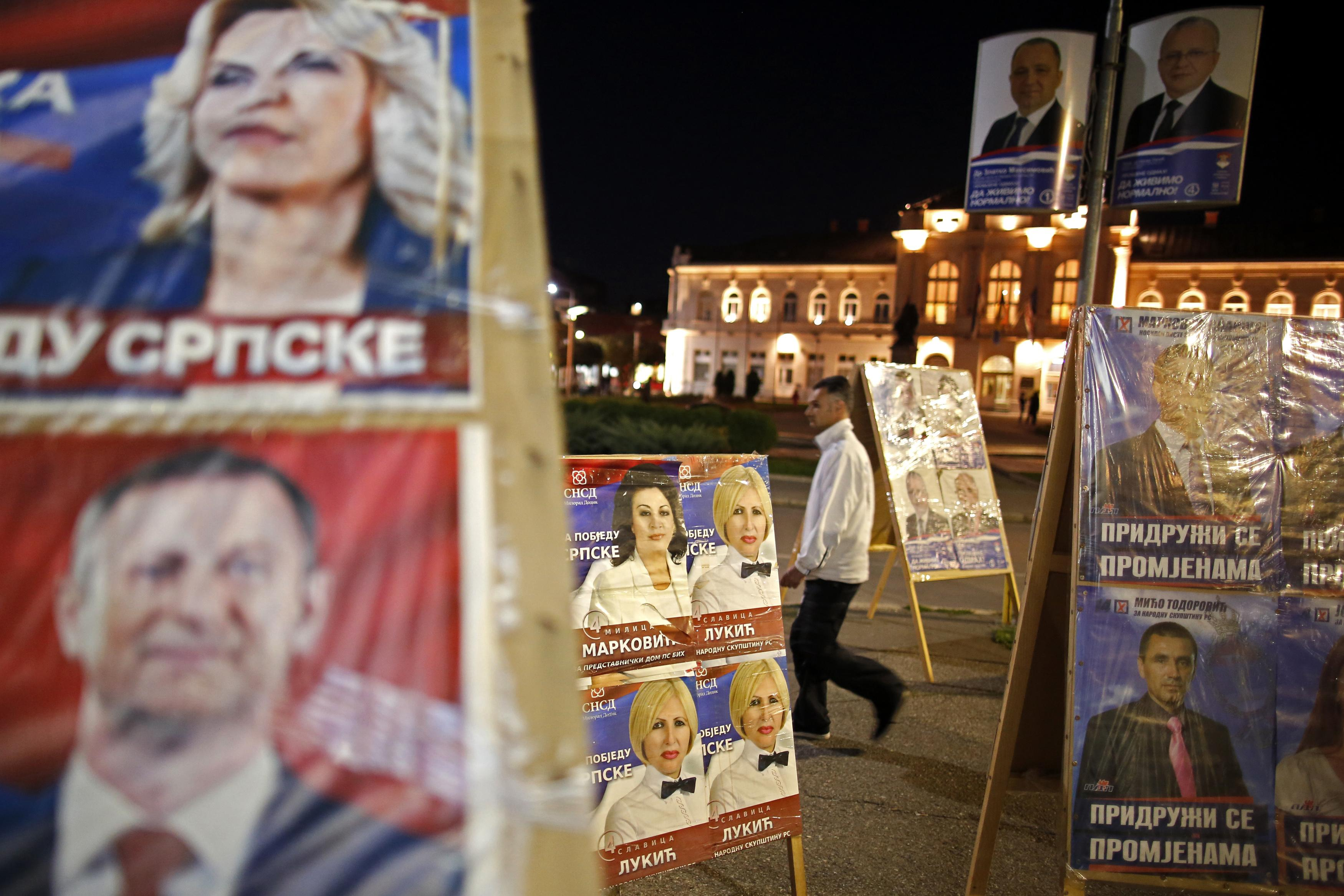 A Serb man walks past election posters in Bijeljina October 9, 2014. Bosnia's 3.3 million voters will choose a new political elite across six layers of government on Sunday in an election that, had it happened a few months ago, might have been a catalyst