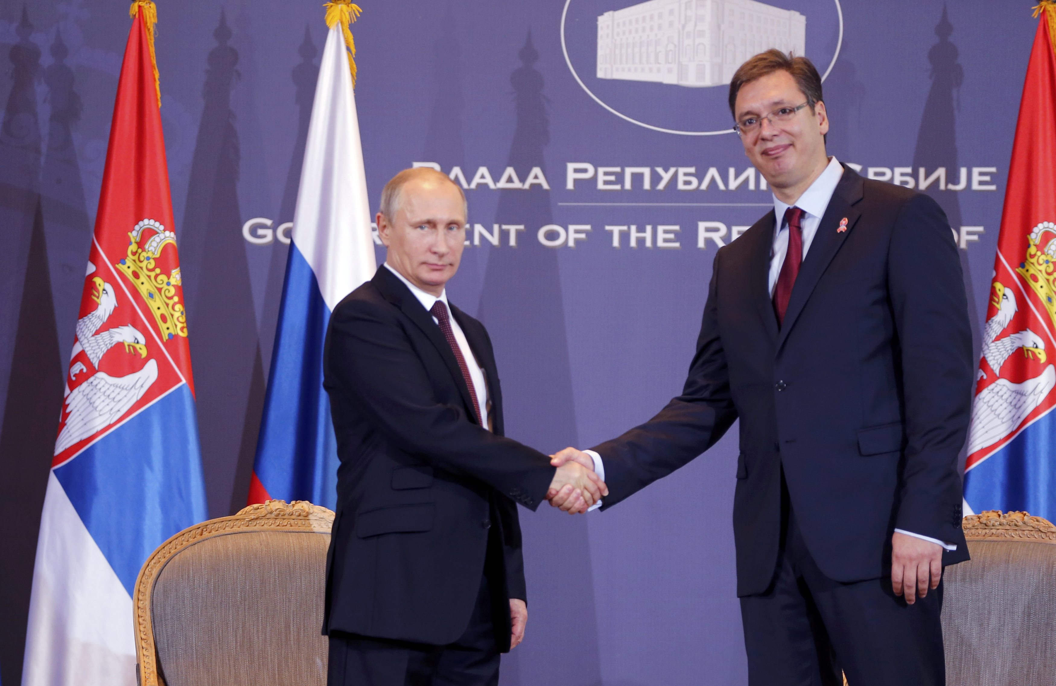 Russian President Vladimir Putin shakes hands with Serbian Prime Minister Aleksandar Vucic (R) at the government headquarters in Belgrade October 16, 2014. Putin is guest of honor at a military parade on Thursday to mark 70 years since the city's liberation by the Red Army, a visit loaded with symbolism as Serbia walks a tightrope between the Europe it wants to join and a big-power ally it cannot leave behind. REUTERS/Marko Djurica (SERBIA - Tags: POLITICS)