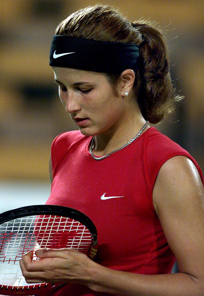 PER14 - 20020101 - PERTH, AUSTRALIA : A dejected Miroslava Vavrinec of Switzerland looks at her racket strings during her match against Arantxa Sanchez-Vicarion of Spain, in the Hopman Cup mixed teams' tennis event at the Burswood Dome in Perth, 01 January 2002. Sanchez-Vicarion won in straight sets 6-2, 6-0. EPA PHOTO AFPI/GREG WOOD