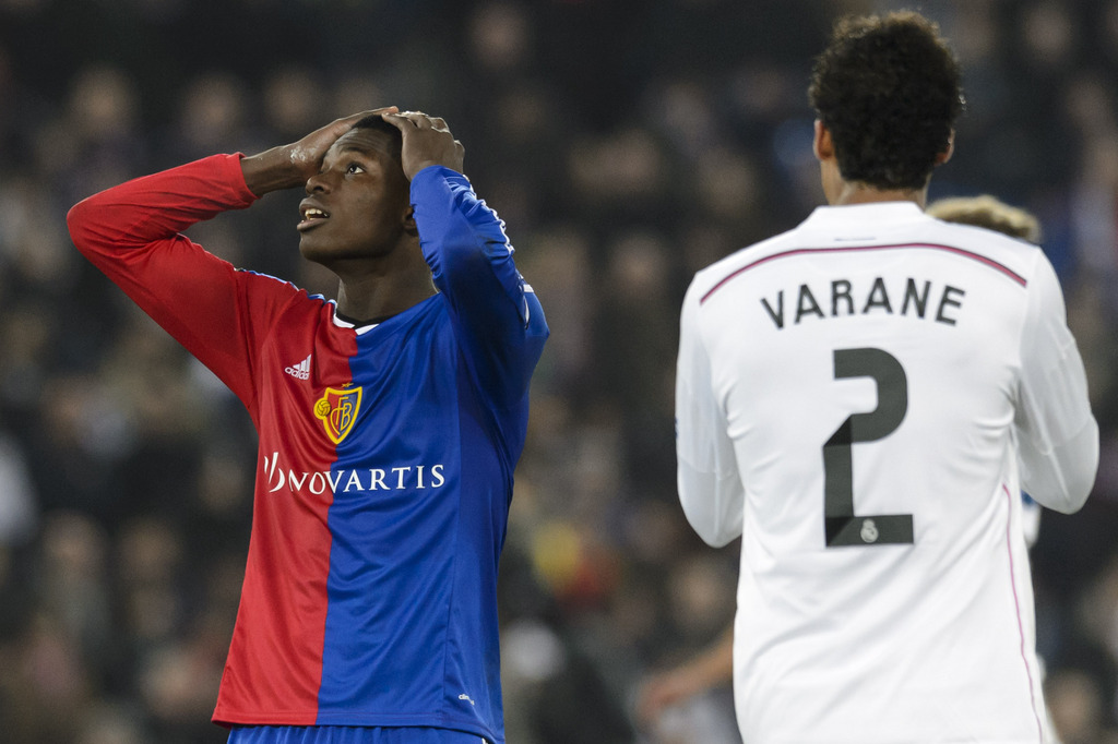 Basel's Breel Embolo, left, freacts next to Madrid�s Raphael Varane, right, during an UEFA Champions League group B matchday 5 soccer match between Switzerland's FC Basel 1893 and Spain's Real Madrid CF in the St. Jakob-Park stadium in Basel, Switzerland, on Wednesday, November 26, 2014. (KEYSTONE/Laurent Gillieron)