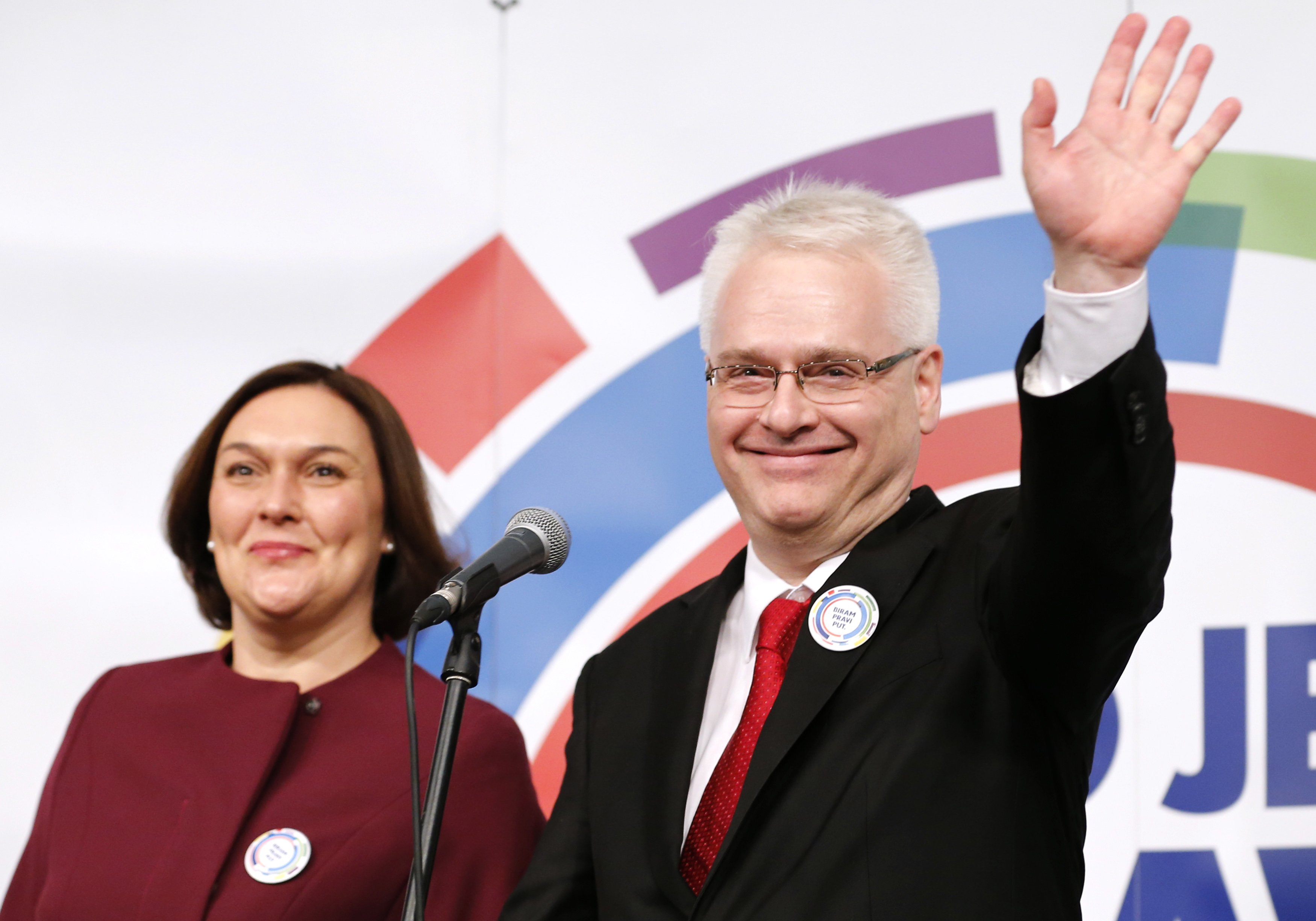 Croatian president and presidential candidate Ivo Josipovic stands with his wife Tatjana Josipovic as he waves to supporters after the unofficial results in the headquarters in Zagreb December 28, 2014. Josipovic faces a tight run-off next month to try to win a second five-year term as Croatia's president after failing to secure a majority from voters frustrated by the country's economic malaise. REUTERS/Antonio Bronic (CROATIA - Tags: POLITICS ELECTIONS)