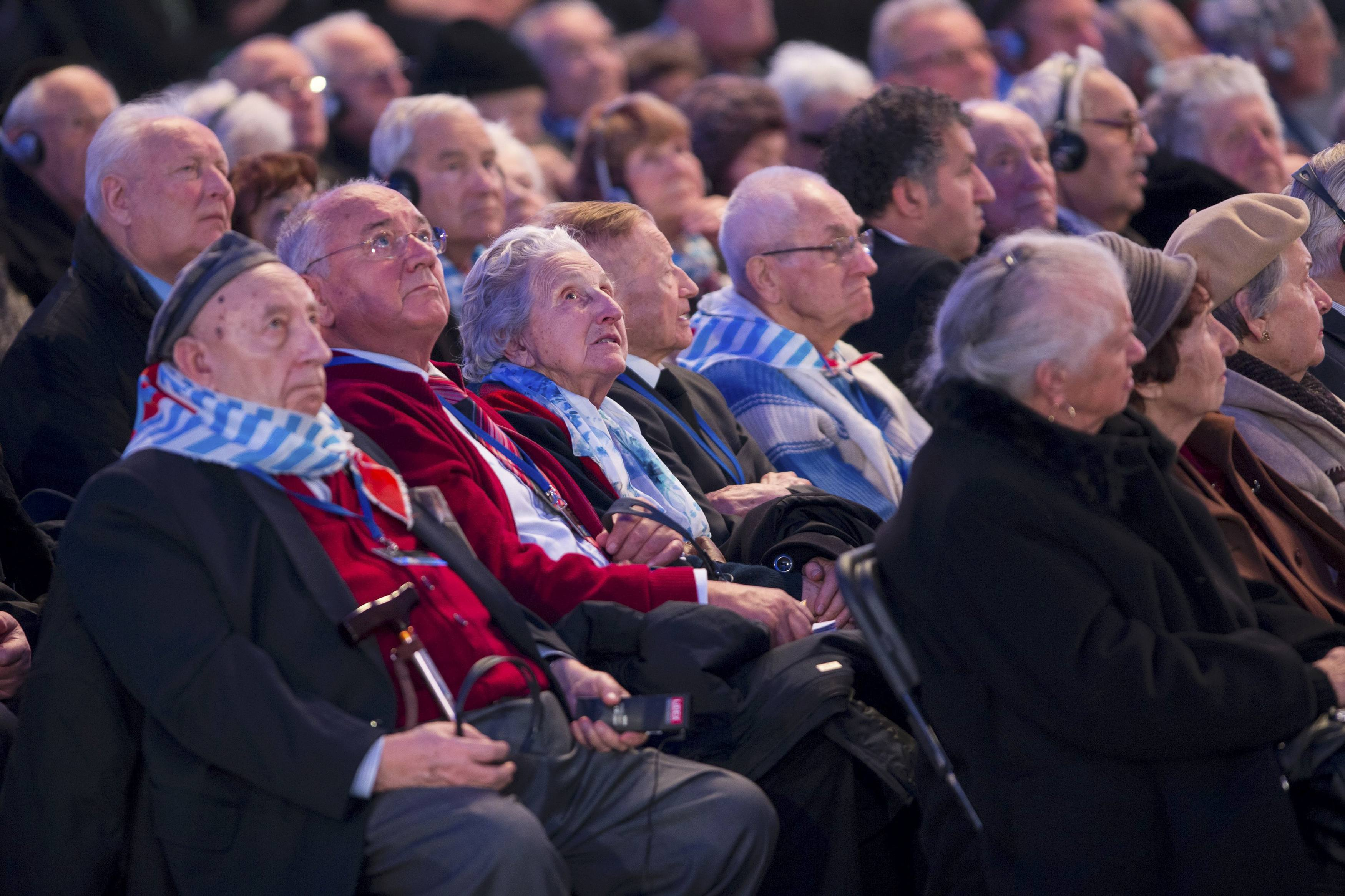 Survivors attend a ceremony on the site of the former Nazi German concentration and extermination camp Auschwitz-Birkenau near Oswiecim January 27, 2015. Ceremonies to mark the 70th anniversary of the liberation of the camp take place on January 27, with some 300 former Auschwitz prisoners taking part in the commemoration event. Nazi Germany built the Auschwitz camp in 1940 as a place of incarceration for the Poles. From 1942, it became the largest site of extermination of the Jews from Europe. In Auschwitz, Nazis killed at least 1.1 million people, mainly Jews, but also Poles, Roma, Soviet prisoners of war and prisoners of other ethnicities. On January 27, 1945 the camp was liberated by the Red Army soldiers. REUTERS/Michal Lepecki/Agencja Gazeta (POLAND - Tags: SOCIETY CONFLICT) THIS IMAGE HAS BEEN SUPPLIED BY A THIRD PARTY. IT IS DISTRIBUTED, EXACTLY AS RECEIVED BY REUTERS, AS A SERVICE TO CLIENTS. POLAND OUT. NO COMMERCIAL OR EDITORIAL SALES IN POLAND.