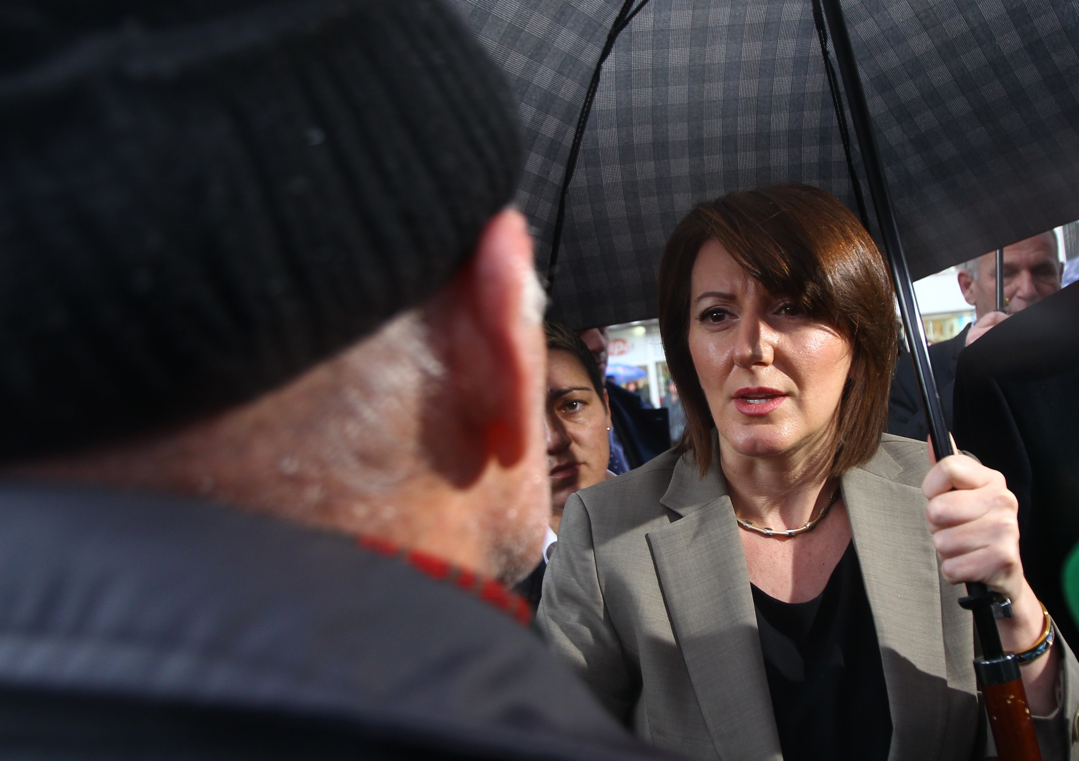 The president of Kosovo, Atifete Jahjaga speaks with people in the town of Vushtrri February 6, 2015. The European Union is experiencing a steep rise in the number of Kosovo citizens smuggling themselves into the affluent bloc, with 10,000 filing for asylum in Hungary in just one month this year compared to 6,000 for the whole of 2013. It follows a relaxation of travel rules allowing Kosovars to reach EU borders via Serbia and has coincided with political turmoil and street unrest in Kosovo fuelled by poverty, high unemployment and economically debilitating corruption. REUTERS/Hazir Reka (KOSOVO - Tags: - Tags: POLITICS)