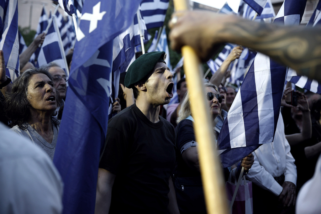 FILE - In this Friday, May 23, 2014 file photo, supporters shout slogans and wave Greek flags during the main election rally of the extreme right party Golden Dawn in Athens. The formerly fringe Nazi-rooted party, which won 0,29 percent in the pre-crisis 2009 elections, saw its popularity explode during the bailout years. (AP Photo/Petros Giannakouris, File)