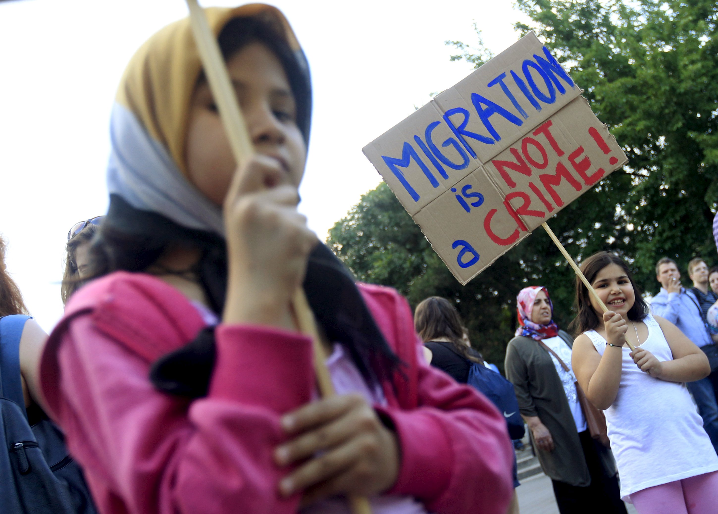 A girl holds a placard during a protest against Hungarian Prime Minister Viktor Orban's immigration policy proposals in central Budapest, Hungary, May 19, 2015. Hungarian Prime Minister Viktor Orban decried EU proposals for migrant quotas as