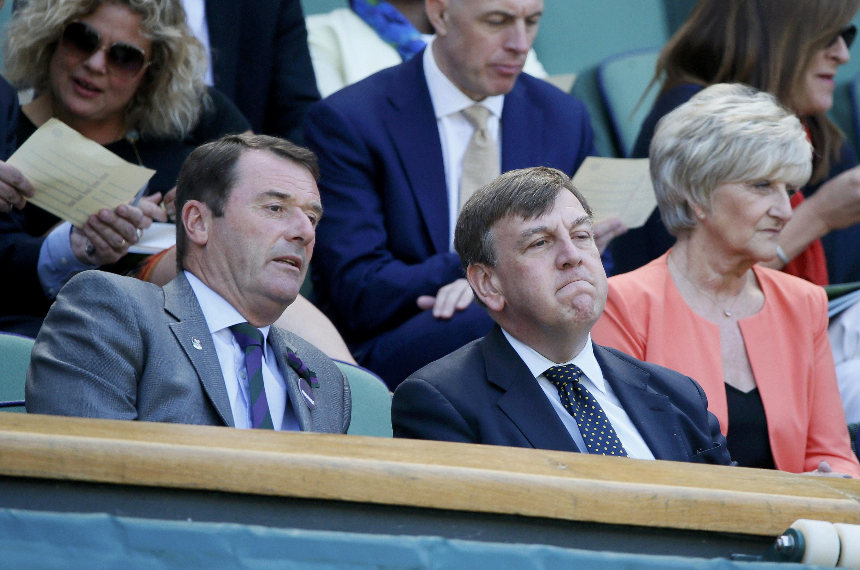 John Whittingdale (C), Secretary of State for Culture, Media and Sport on Centre Court at the Wimbledon Tennis Championships in London, July 9, 2015. REUTERS/Stefan Wermuth