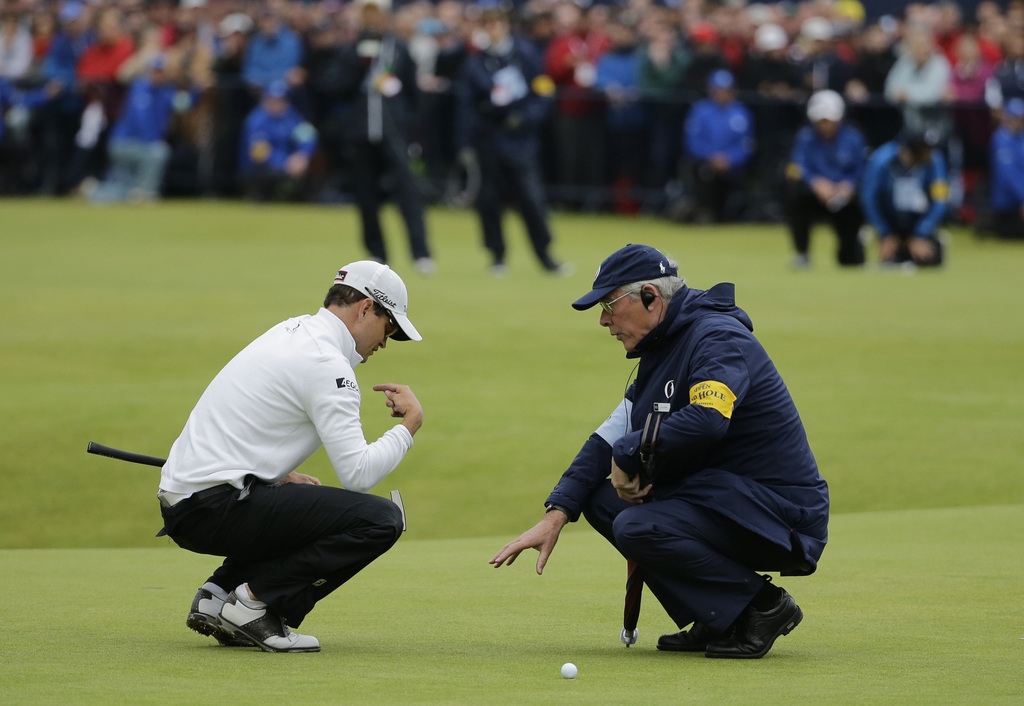 United States� Zach Johnson talks with an official before putting on the 18th during a playoff after the final round at the British Open Golf Championship at the Old Course, St. Andrews, Scotland, Monday, July 20, 2015. (AP Photo/David J. Phillip)