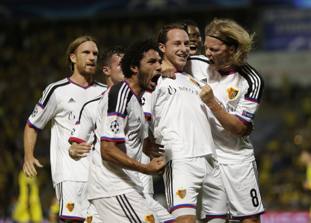 FC Basel players celebrate scoring a first goal during the UEFA Champions League play-off round second leg soccer match between Switzerland's FC Basel and Israel's Maccabi Tel Aviv FC in Bloomfield stadium in Tel Aviv, Israel, Tuesday, Aug. 25, 2015 . (AP Photo/Ariel Schalit)
