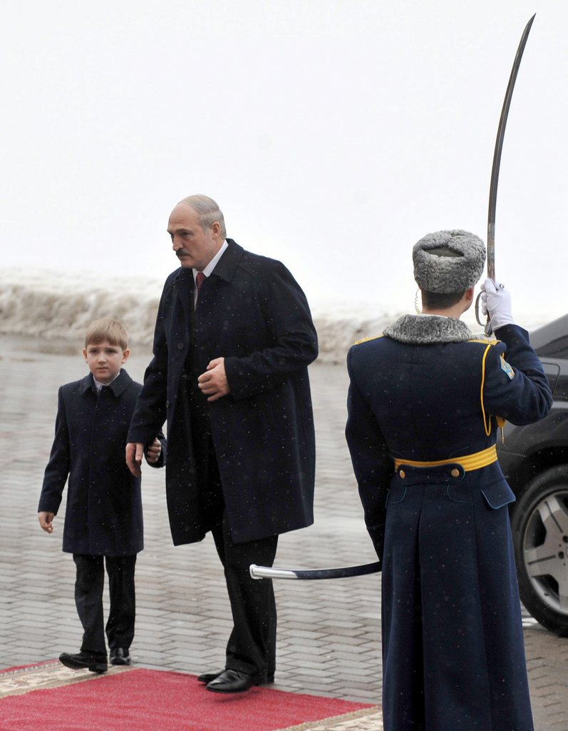 epa02541743 Belarus President Alexander Lukashenko (C) and his son Nikolay 'Kolya' Lukashenko (L) arrive to attend his swearing-in ceremony at the Palace of the Republic in Minsk, Belarus, 21 January 2011. Lukashenko was sworn in for a fourth term, facing total isolation by the West over a crackdown on the Belarus opposition after his disputed election victory. EPA/VIKTOR DRACHEV / POOL
