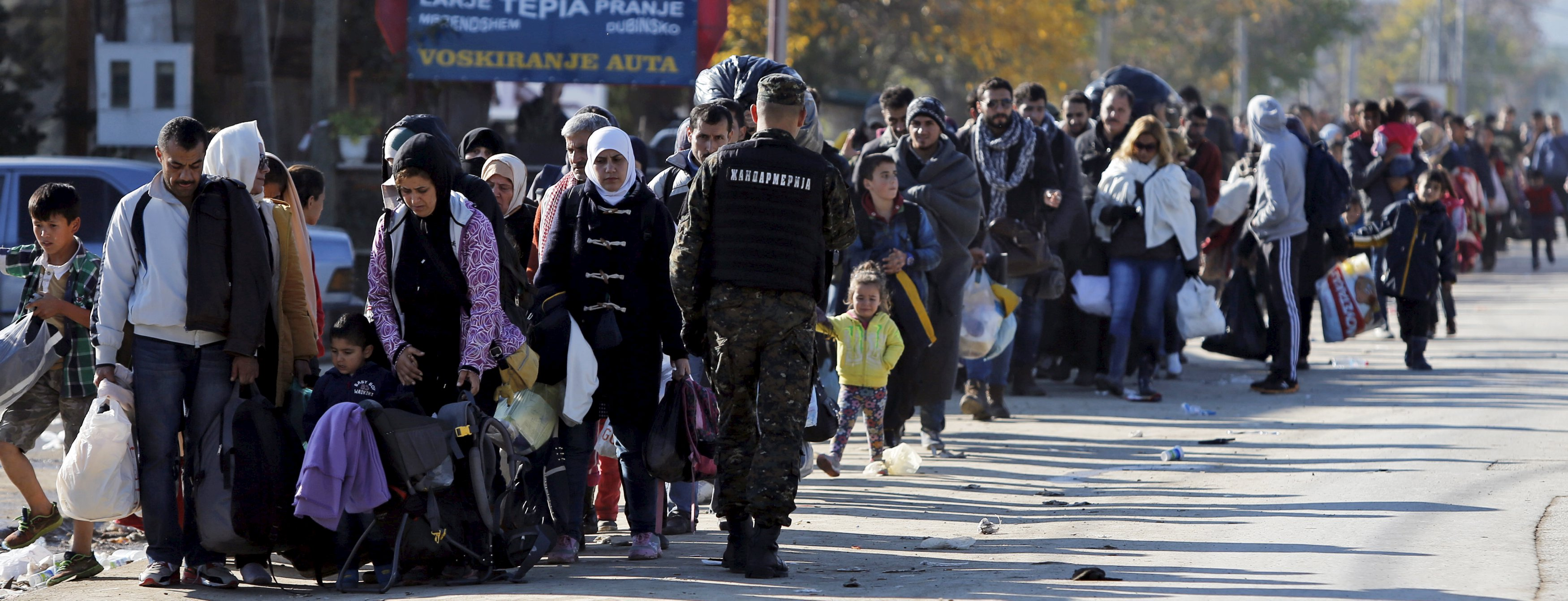 <p>Migrants wait to enter a registration camp in Preshevo , Serbia October 25, 2015. Europe's chief executive Jean-Claude Juncker will on Sunday meet with leaders from central and eastern Europe to push for a coordinated response to the influx of refugees before winter sets in. Juncker, who heads the European Commission, has called leaders of Austria, Bulgaria, Croatia, Macedonia, Germany, Greece, Hungary, Romania, Serbia and Slovenia, plus refugee organizations involved, to attend the meeting in Brussels. REUTERS/Ognen Teofilovski</p>