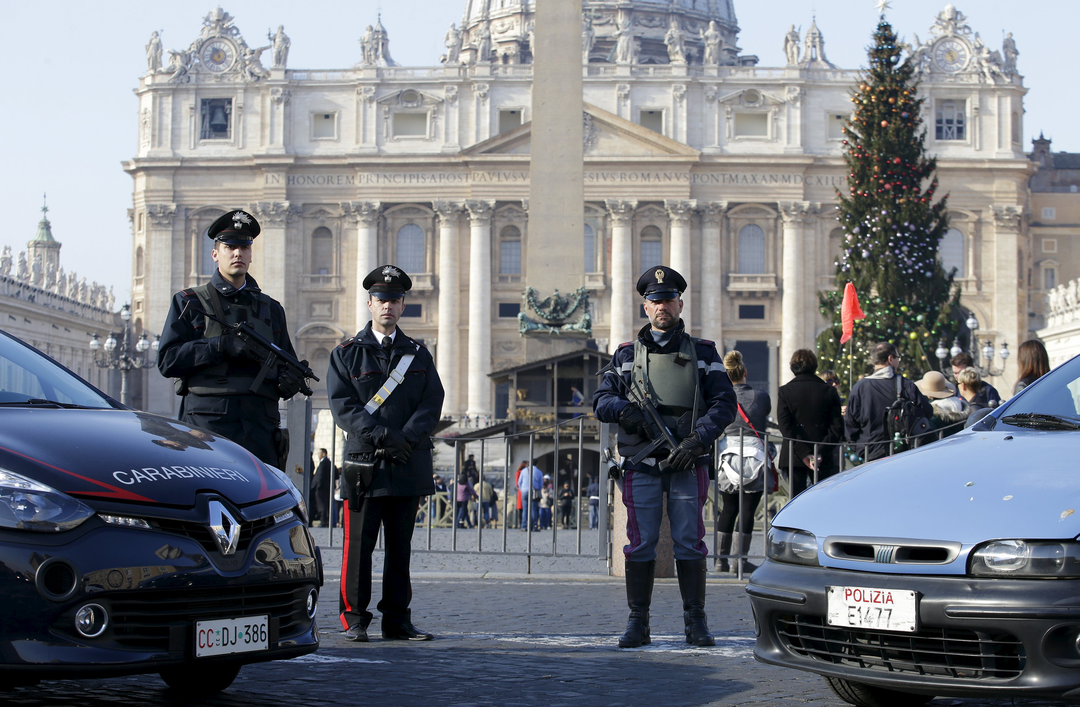 A policeman (R) and Carabinieri patrol in front of the Vatican in Rome, Italy, December 4, 2015. Rome is bracing for the arrival of millions of pilgrims for the Roman Catholic Holy Year which officials had hoped could revitalise the scandal-plagued city, but which threatens to be more of a headache than a help. During the 12-month Jubilee, Catholics coming to the Eternal City can gain indulgences, which, they believe, might speed their passage to heaven. REUTERS/Max Rossi