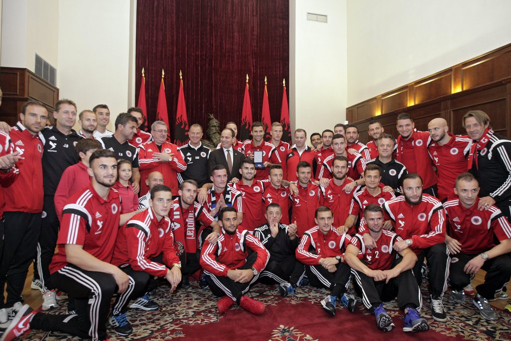 epa04975241 The Albanian national soccer team poses for a picture with Albanian President Bujar Nishani (C) after receiving the Medal of Honour in Tirana, Albania, 12 October 2015. Thousands of Albanians turned out in the capital Tirana to welcome the national football team after it secured the country's first-ever place at a major finals. Albania the previous day secured second spot in Euro 2016 qualifying Group I with a 3-0 win away to Armenia. EPA/FLORION GOGA