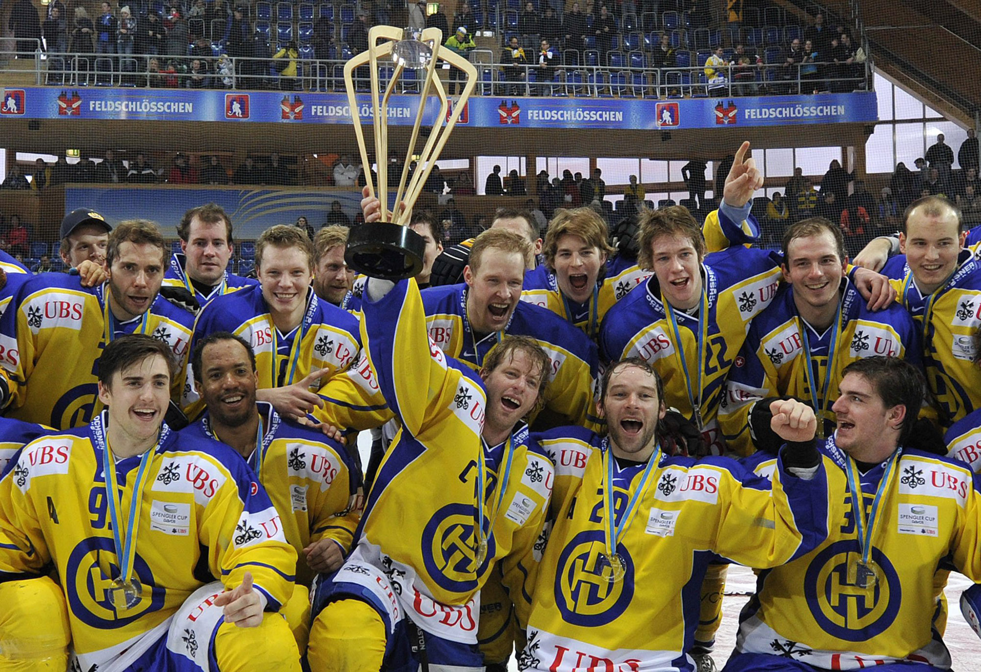 Davos players celebrate their victory after the final game between HC Davos and Dynamo Riga at the 85th Spengler Cup ice hockey tournament, in Davos, Switzerland, Saturday, December 31, 2011. (KEYSTONE/ Peter Schneider)