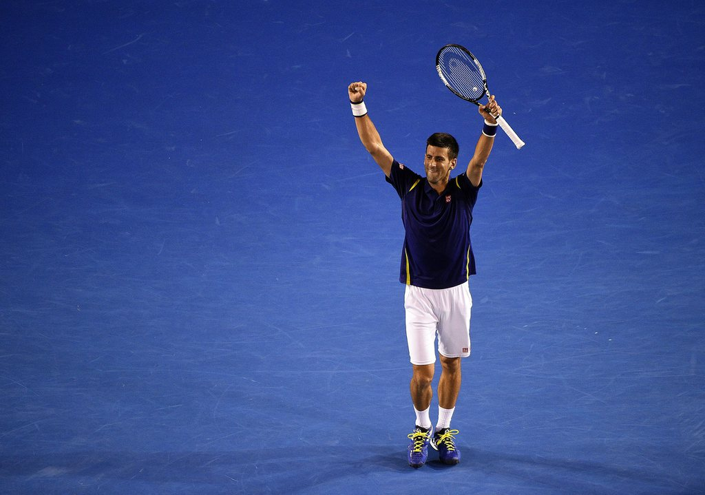 epa05131400 Novak Djokovic of Serbia celebrates his win against Roger Federer of Switzerland during their semi final match on day eleven of the Australian Open tennis tournament in Melbourne, Australia, 28 January 2016. EPA/JOE CASTRO AUSTRALIA AND NEW ZEALAND OUT