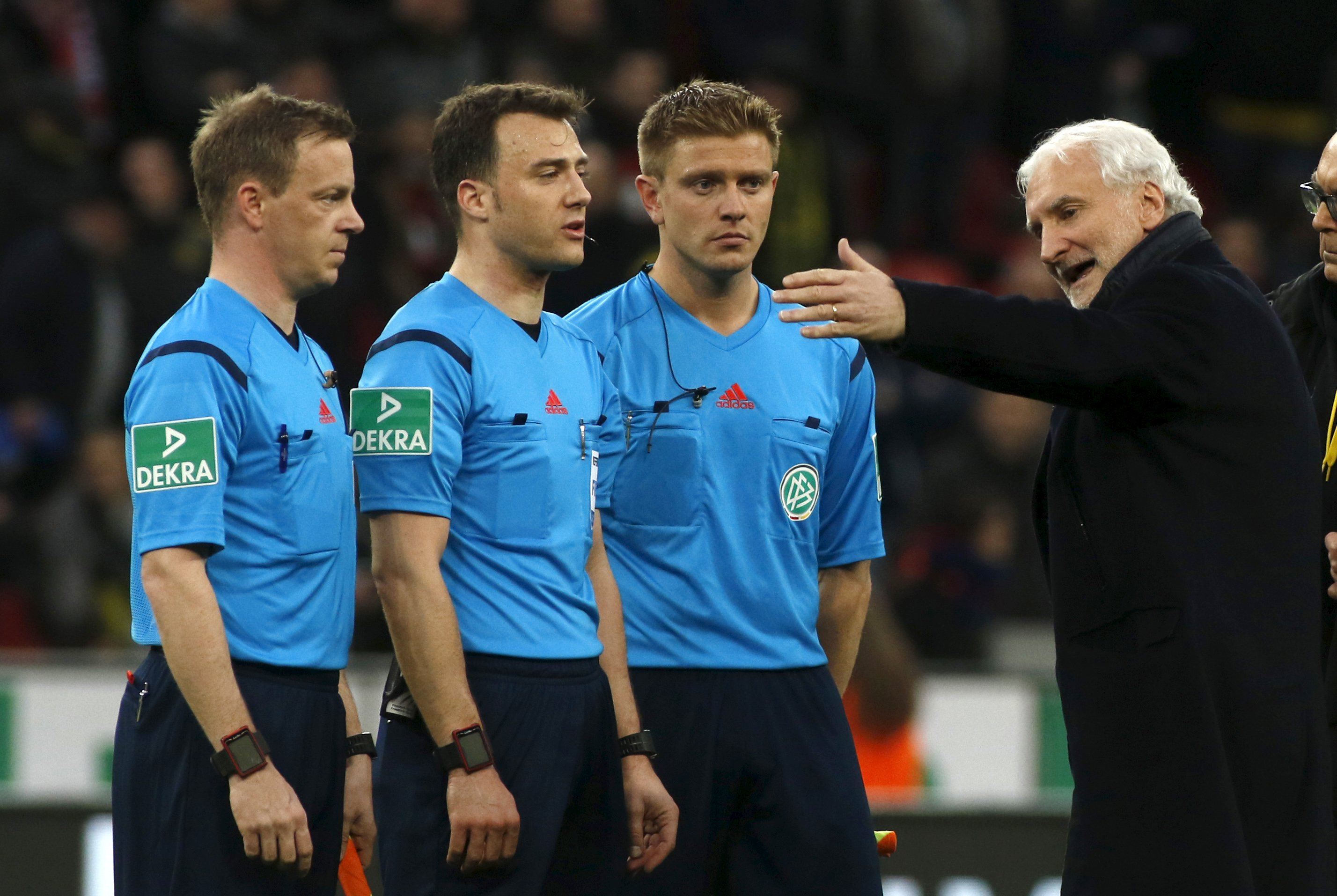 Football Soccer -- Bayer Leverkusen v Borussia Dortmund - German Bundesliga - BayArena , Leverkusen, 21/02/16 Leverkusen's sport director Rudi Voeller (R) discusses with referees after the match. REUTERS/Ina Fassbender DFL RULES TO LIMIT THE ONLINE USAGE DURING MATCH TIME TO 15 PICTURES PER GAME. IMAGE SEQUENCES TO SIMULATE VIDEO IS NOT ALLOWED AT ANY TIME. FOR FURTHER QUERIES PLEASE CONTACT DFL DIRECTLY AT + 49 69 650050