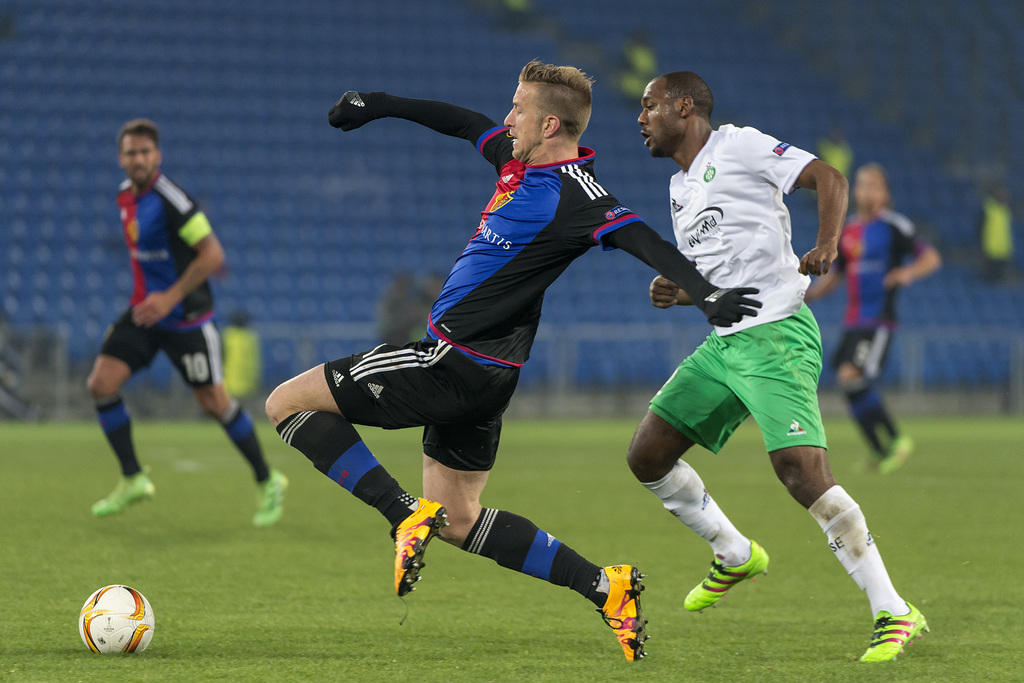 Basel's Marc Janko, left, fights for the ball against Saint-Etienne's Kevin Theophile-Catherine, right, during the UEFA Europa League Round of 32 second leg soccer match between Switzerland's FC Basel 1893 and France�s AS Saint-Etienne at the St. Jakob-Park stadium in Basel, Switzerland, on Thursday, February 25, 2016. (KEYSTONE/Georgios Kefalas)