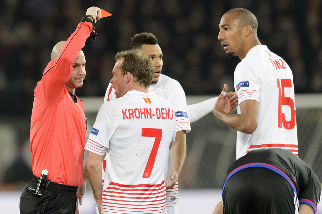 British referee Anthony Taylor, left, gives a red card to Sevilla's Steven N'Zonzi, right, during the UEFA Europa League Round of 16 first leg soccer match between Switzerland's FC Basel 1893 and Spain's Sevilla Futbol Club at the St. Jakob-Park stadium in Basel, Switzerland, on Thursday, March 10, 2016. (KEYSTONE/Laurent Gillieron)