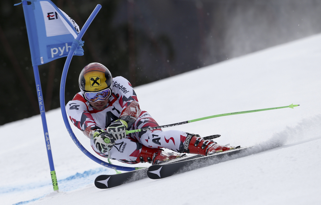 Austria's Marcel Hirscher speeds down the course during the first run of an Alpine ski World Cup men's giant slalom race, in Hinterstoder, Austria, Friday, Feb. 26, 2016. (AP Photo/Alessandro Trovati)