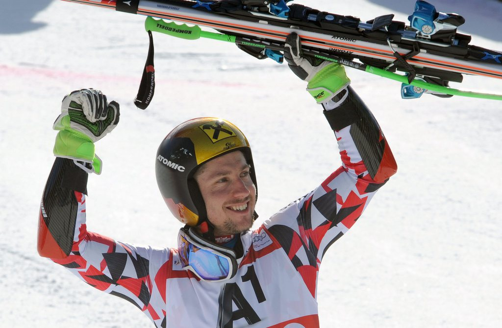 epa05181972 Second placed Marcel Hirscher of Austria celebrates during the podium ceremony of the men's Alpine Skiing World Cup Giant Slalom race in Hinterstoder, Austria, 26 February 2016. EPA/EXPA/ERICH SPIESS