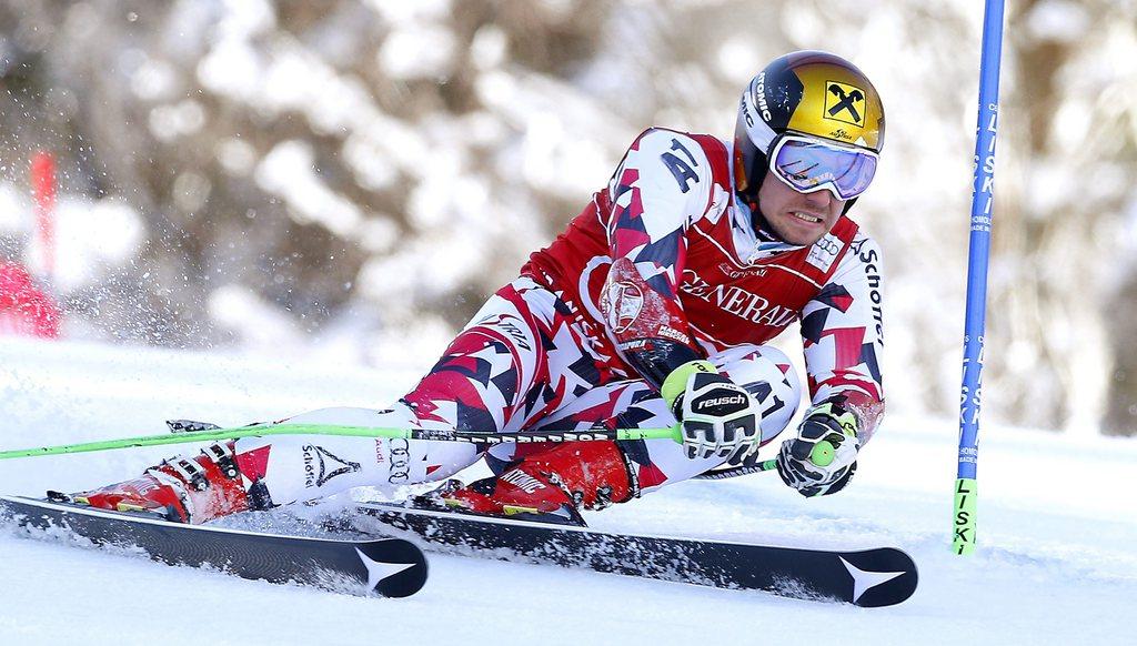epa05193760 Marcel Hirscher of Austria clears a gate during the first run of the men's Giant Slalom race of the Alpine Skiing World Cup in Kranjska Gora, Slovenia, 04 March 2016. EPA/ANTONIO BAT