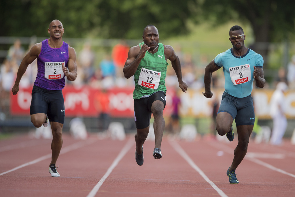Alex Wilson, centre, Reto Amaru Schenkel, right, and Rolf Malcolm Fongue, left, from Switzerland during the men's 100m race at the International Athletics Meeting in Lucerne, Switzerland, Tuesday, July 14, 2015. (KEYSTONE/Urs Flueeler)