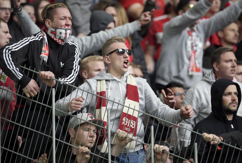 Supporters of Stuttgart shout after the German Bundesliga soccer match between VfL Wolfsburg and VfB Stuttgart in Wolfsburg, Germany, Saturday, May 14, 2016. Wolfsburg defeated Stuttgart by 3-1. (AP Photo/Michael Sohn)