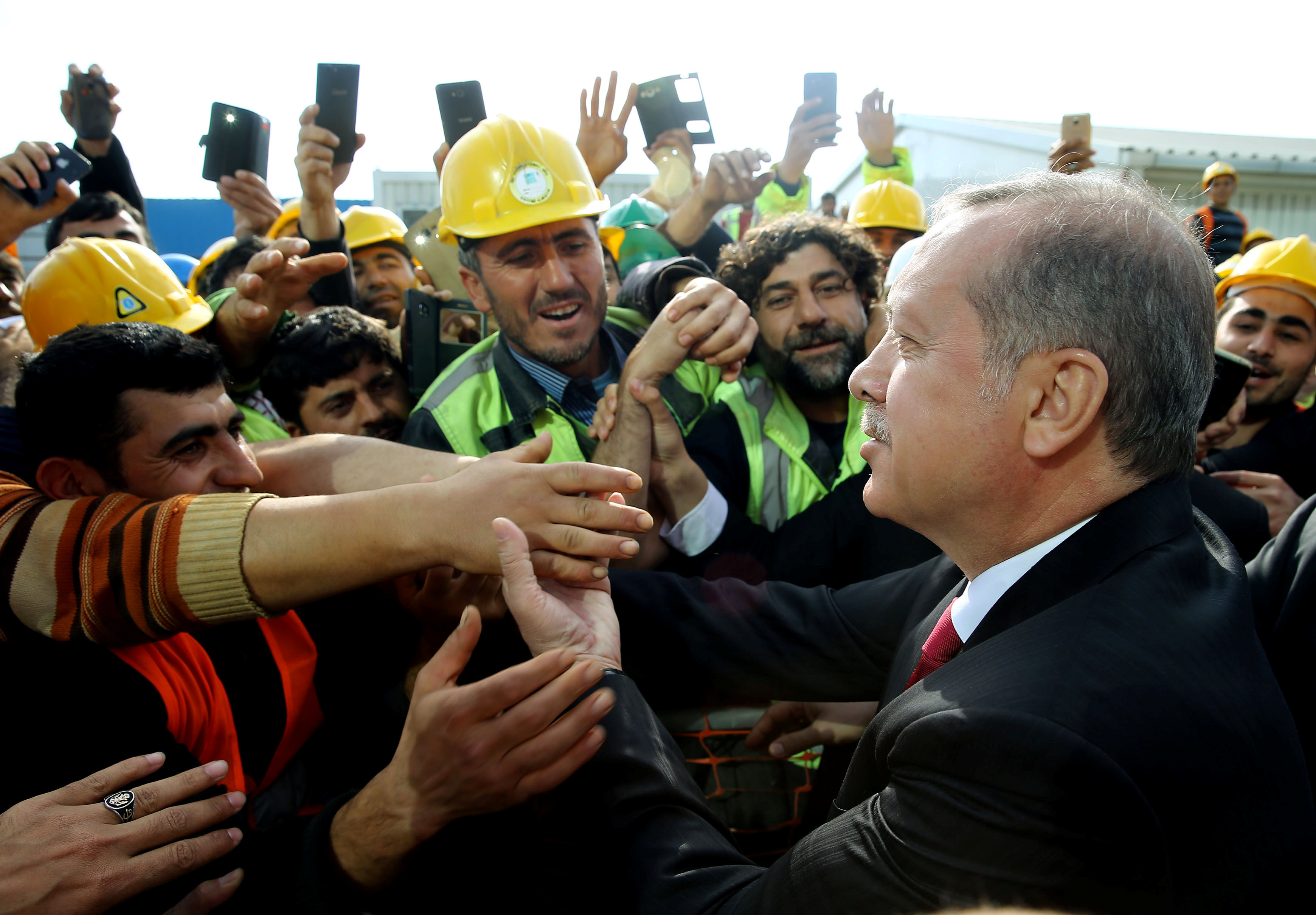 Turkish President Tayyip Erdogan meets with workers during his visit to the construction site of the city's third airport in Istanbul, Turkey May 9, 2016.