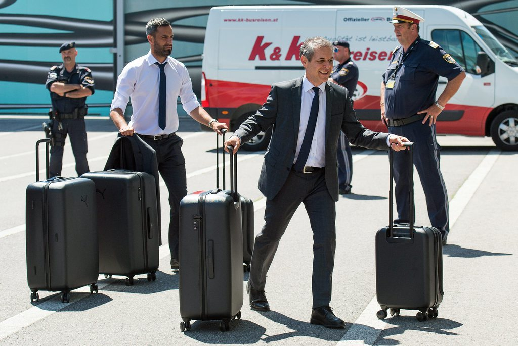 epa05351293 Austrian national soccer team's Swiss head coach Marcel Koller (front R) and goalkeeper Ramazan Oezcan (2-L) during their team's departure to France at Vienna International Airport in Schwechat, Austria, 08 June 2016. The Austrian national soccer team will take part in the upcoming UEFA EURO 2016 soccer championship in France. EPA/CHRISTIAN BRUNA