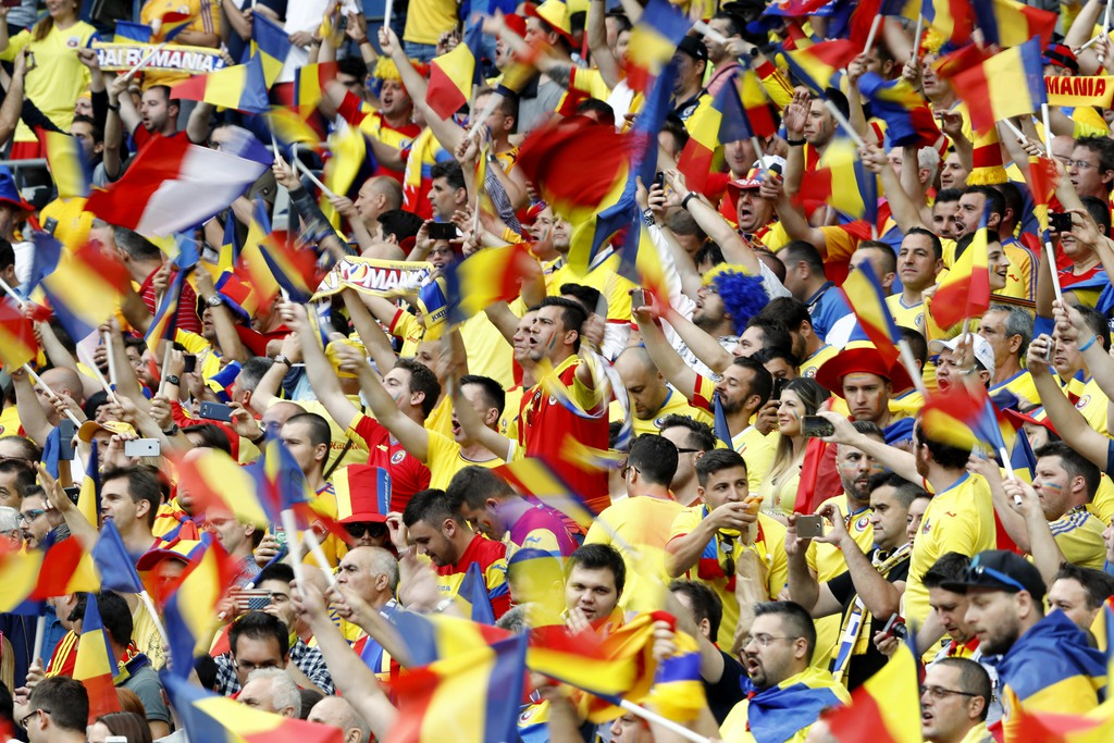 Romanian fans wave their flags and scarves prior to the Euro 2016 Group A soccer match between France and Romania, at the Stade de France, in Saint-Denis, north of Paris, Friday, June 10, 2016. (AP Photo/Frank Augstein)