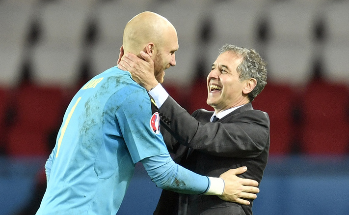 Austria goalkeeper Robert Almer, left, celebrates with Austria coach Marcel Koller at the end of the Euro 2016 Group F soccer match between Portugal and Austria at the Parc des Princes stadium in Paris, France, Saturday, June 18, 2016. (AP Photo/Martin Meissner)