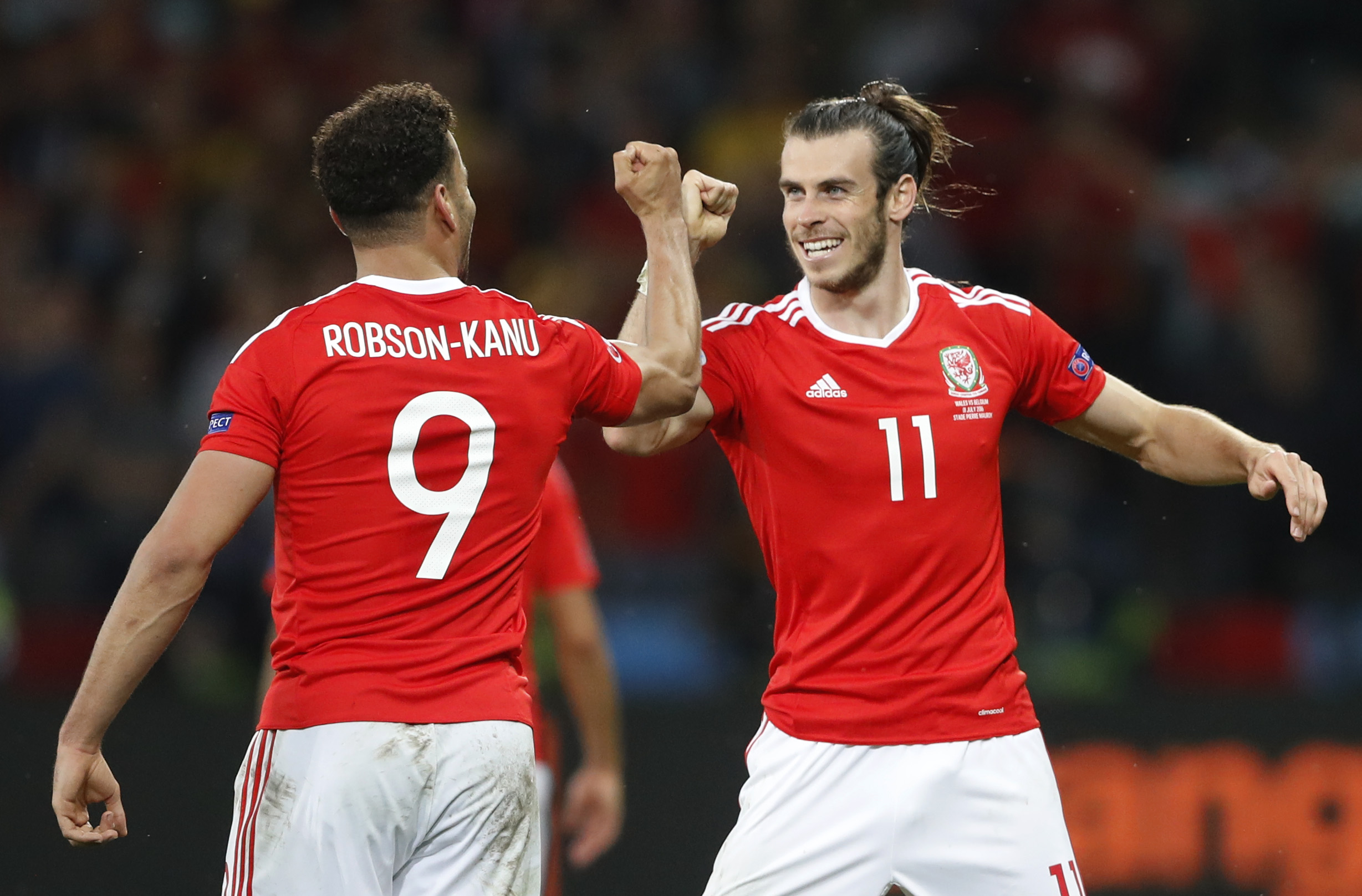 Football Soccer - Wales v Belgium - EURO 2016 - Quarter Final - Stade Pierre-Mauroy, Lille, France - 1/7/16 Wales' Hal Robson-Kanu celebrates with Gareth Bale after scoring their second goal REUTERS/Carl Recine Livepic