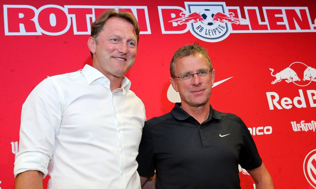 epa05420558 Ralph Hasenhuettl (L), new head coach of German Bundesliga soccer club RasenBallsport Leipzig, poses next to sports director Ralf Rangnick after a press conference held in the Red Bull training centre in Leipzig, Germany, 11 July 2016. Hasenhuettl has signed a three-year contract with the club. EPA/JAN WOITAS