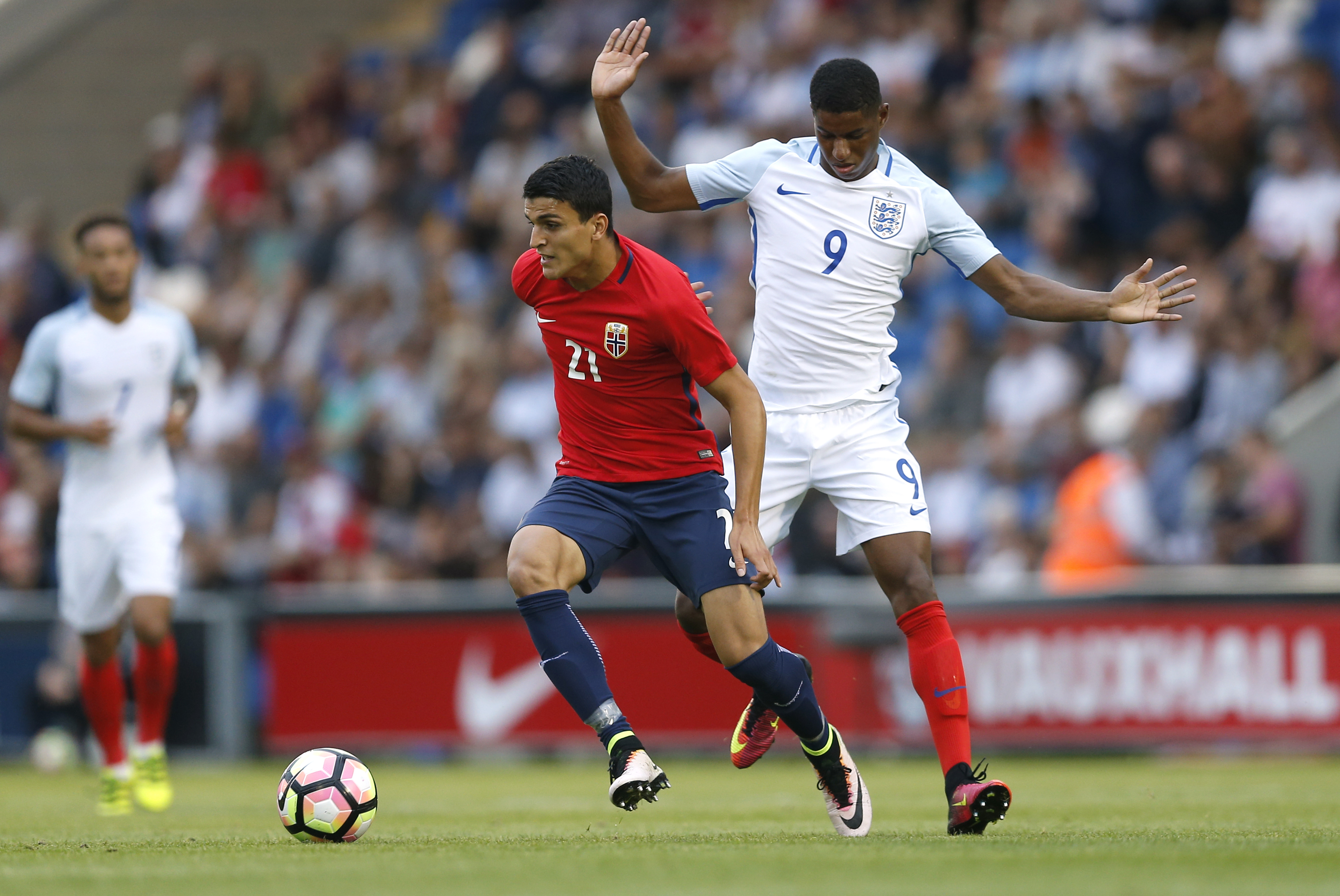 Britain Football Soccer - England v Norway - UEFA European Under 21 Championship Qualifying Group Nine - Weston Homes Community Stadium - 6/9/16 England's Marcus Rashford in action with Norway's Mohamed Elyounoussi Action Images via Reuters / Matthew Childs Livepic EDITORIAL USE ONLY.
