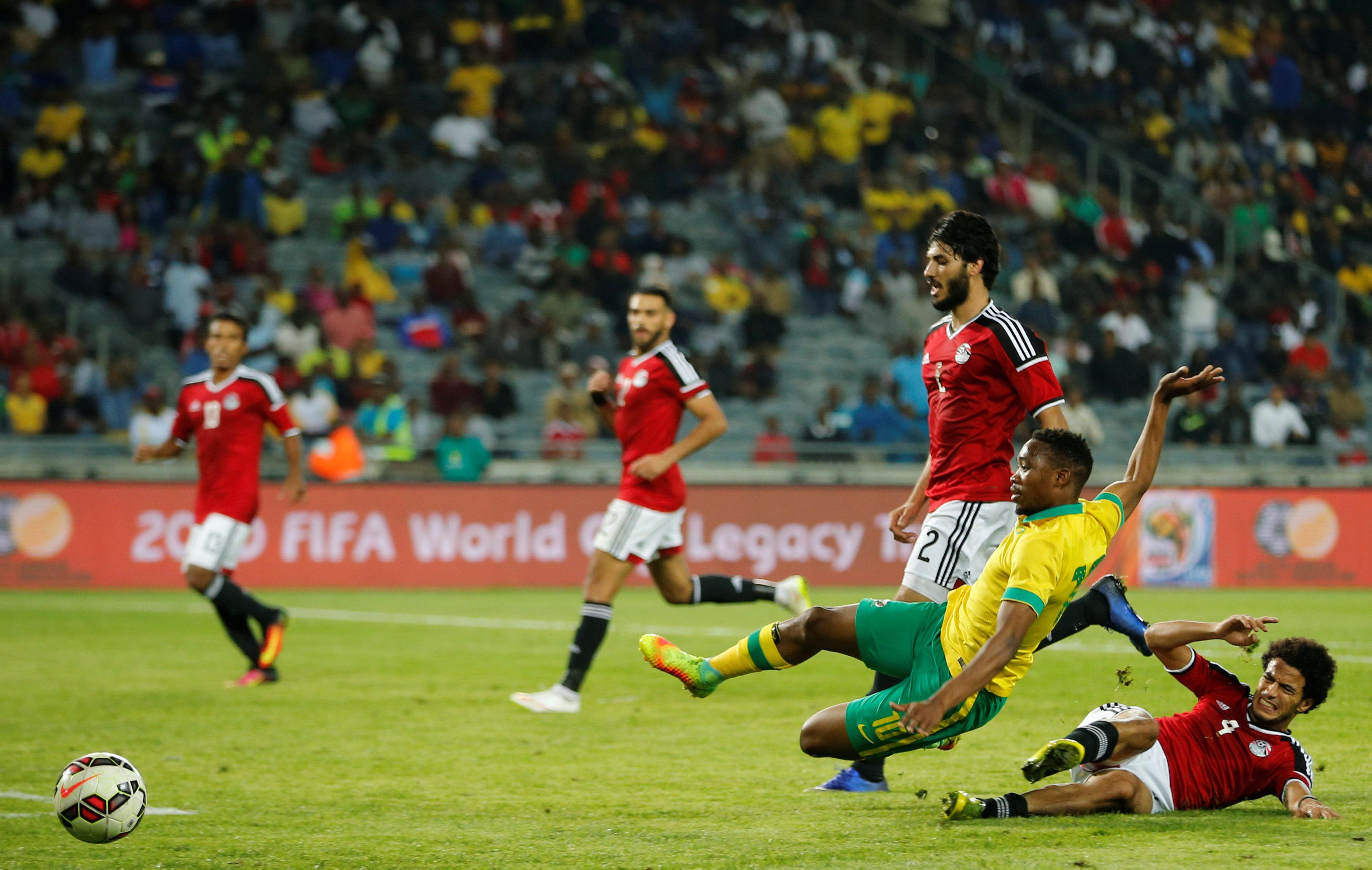 Football Soccer - South Africa v Egypt - Nelson Mandela Challenge soccer match - Orlando Stadium, Soweto, South Africa - 6/9/16 South Africa's Sibusiso Vilakazi (L) is tackled by Egypt's Omar Gaber. REUTERS/Siphiwe Sibeko