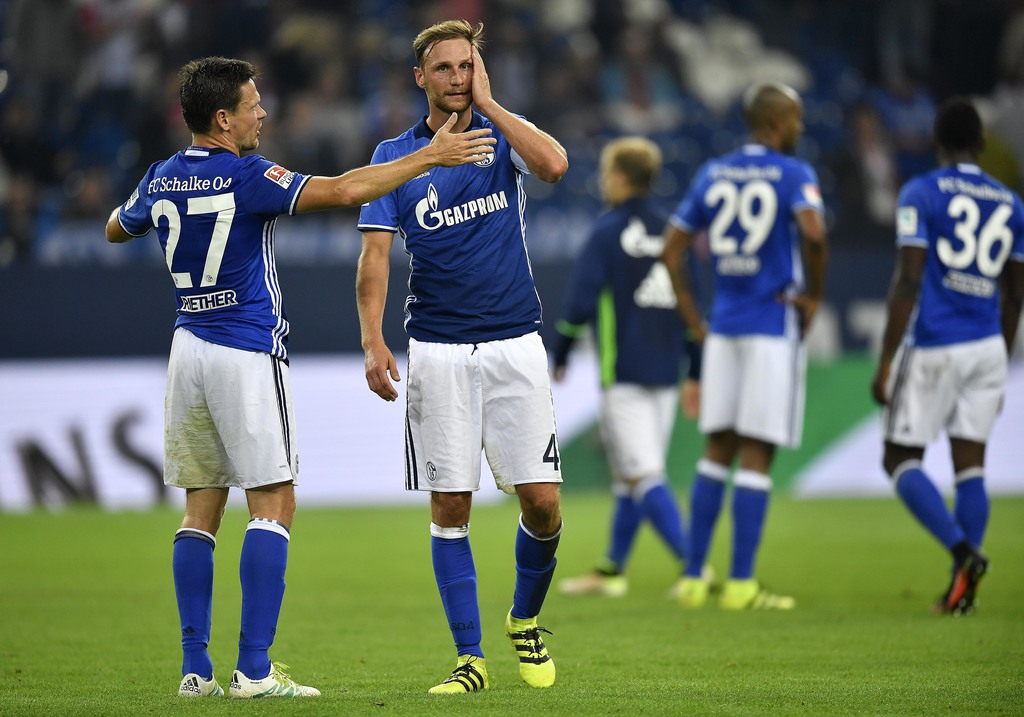 Schalke's Sascha Riether, left, and Schalke's Benedikt Hoewedes stand disappointed after losing the German Bundesliga soccer match between FC Schalke 04 and 1. FC Cologne in Gelsenkirchen, Germany, Wednesday, Sept. 21, 2016. Schalke was defeated by Cologne with 1-3. (AP Photo/Martin Meissner)