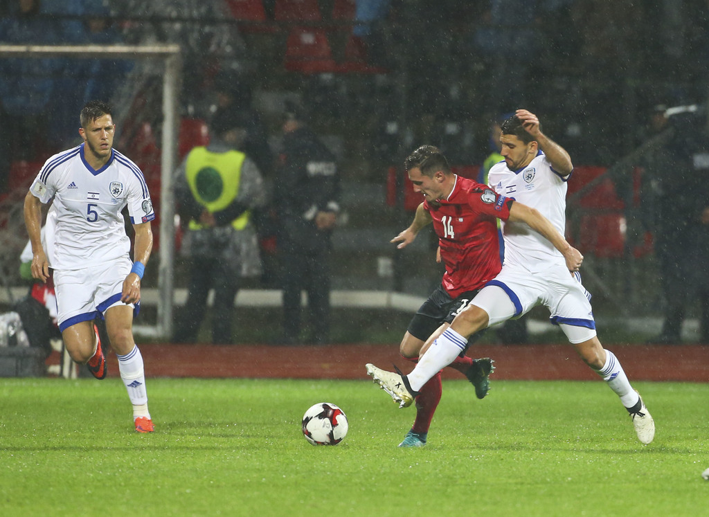 Albania's Taulant Xhaka,second right, fights for the ball with Israel's Daniel Einbinder, during the World Cup Group G qualifying soccer match between Albania and Israel, at Elbasan Arena stadium, in Elbasan, Albania, Saturday, Nov. 12, 2016. (AP Photo/Hektor Pustina)