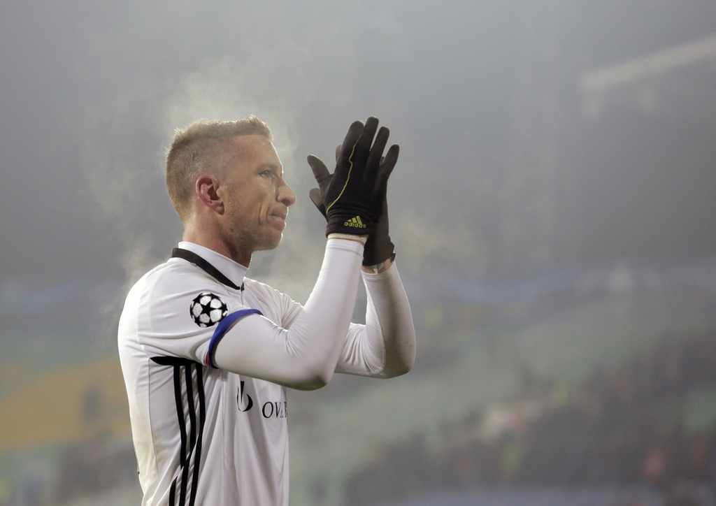 Basel's Marc Janko applauds Basel's fans after drawing with Ludogorets during the Champions League group A soccer match between Ludogorets and FC Basel 1893, at Vassil Levski stadium in Sofia, Bulgaria, Wednesday, Nov. 23, 2016. (AP Photo/Valentina Petrova)