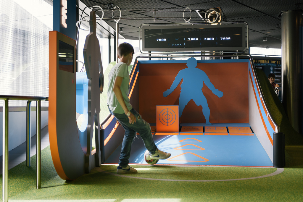 A child plays pinball football at the FIFA World Football Museum in Zurich, Switzerland, on May 17, 2016. Exhibits at the museum, which is owned and operated by FIFA, include memorabilia from every FIFA World Cup and FIFA Women's World Cup. (KEYSTONE/Christian Beutler)