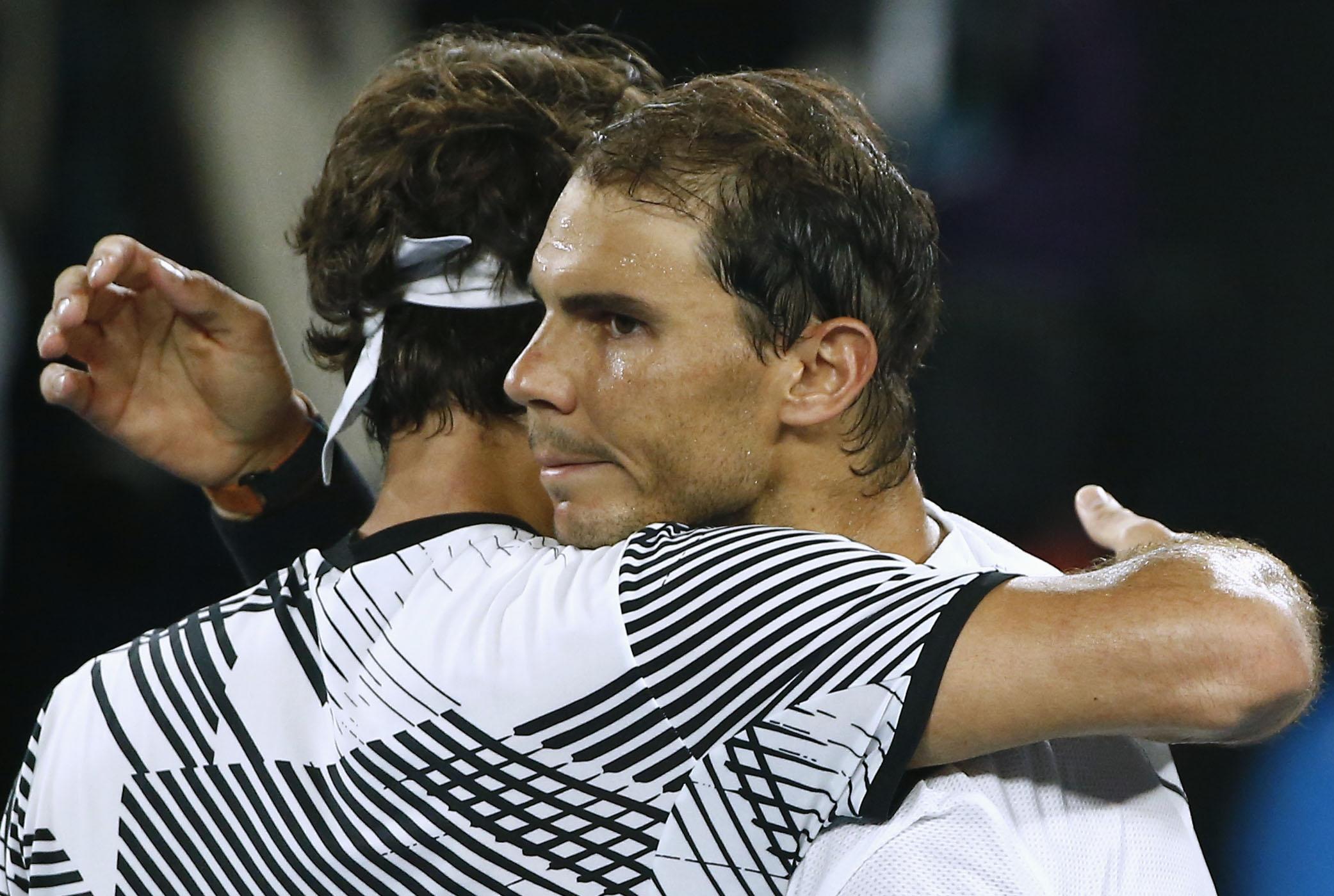 Tennis - Australian Open - Melbourne Park, Melbourne, Australia - 29/1/17 Switzerland's Roger Federer embraces after winning his Men's singles final match against Spain's Rafael Nadal. REUTERS/Thomas Peter