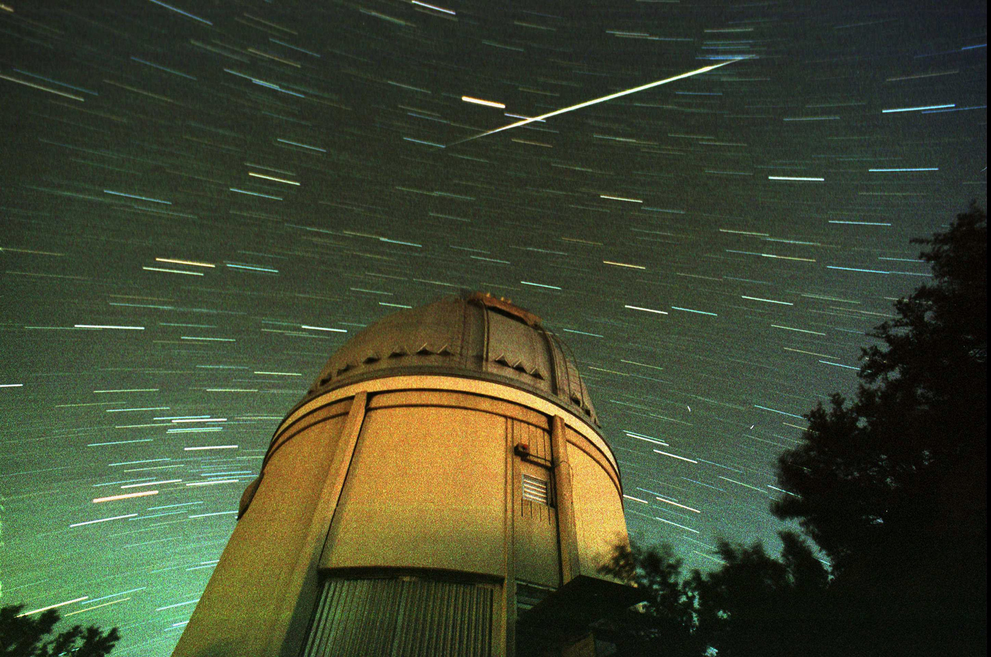 Stars spin across the photograph during a time exposure of the 36-inch Spacewatch telescope at Kitt Peak National Observatory