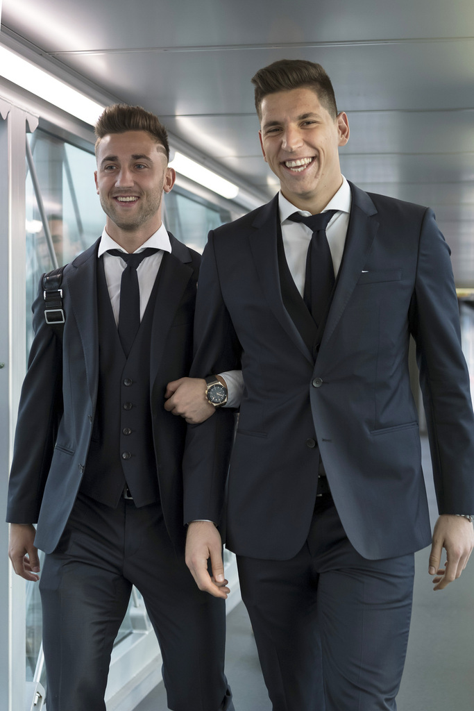 Andraz Sporar, left, and goalkeeper Djordje Nikolic, right, of Switzerland's FC Basel 1893 on their departure at the EuroAirport in Basel, Switzerland, on Tuesday, November 22, 2016. Switzerland's FC Basel 1893 is scheduled to play an UEFA Champions League Group stage Group A matchday 5 soccer match against Bulgaria's PFC Ludogorets Razgrad on Wednesday, November 23, 2016. (KEYSTONE/Georgios Kefalas)